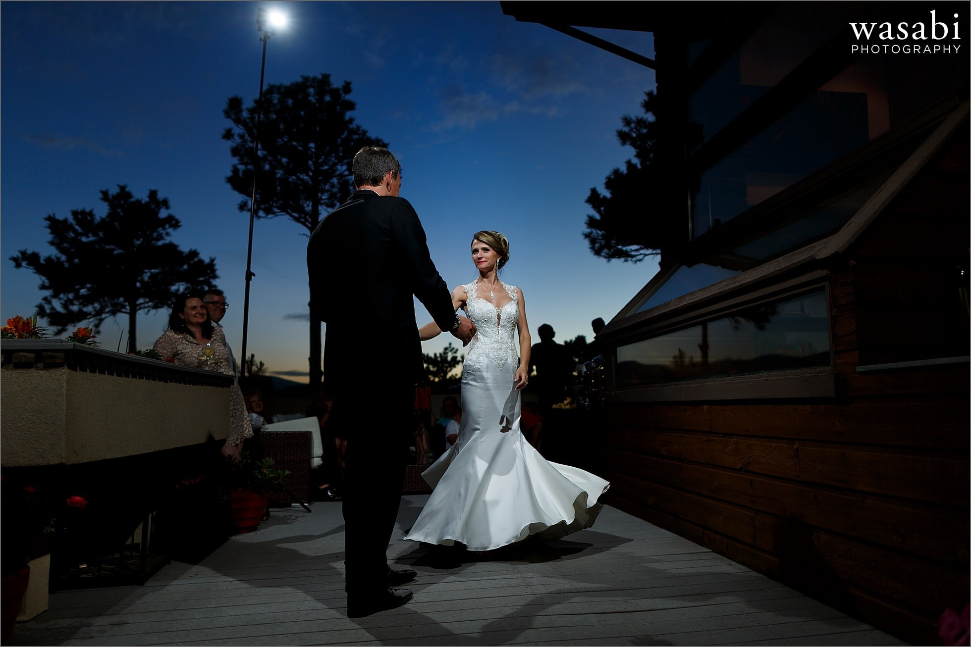 first dance at dusk during wedding reception at couples home on Lookout Mountain in Golden Colorado