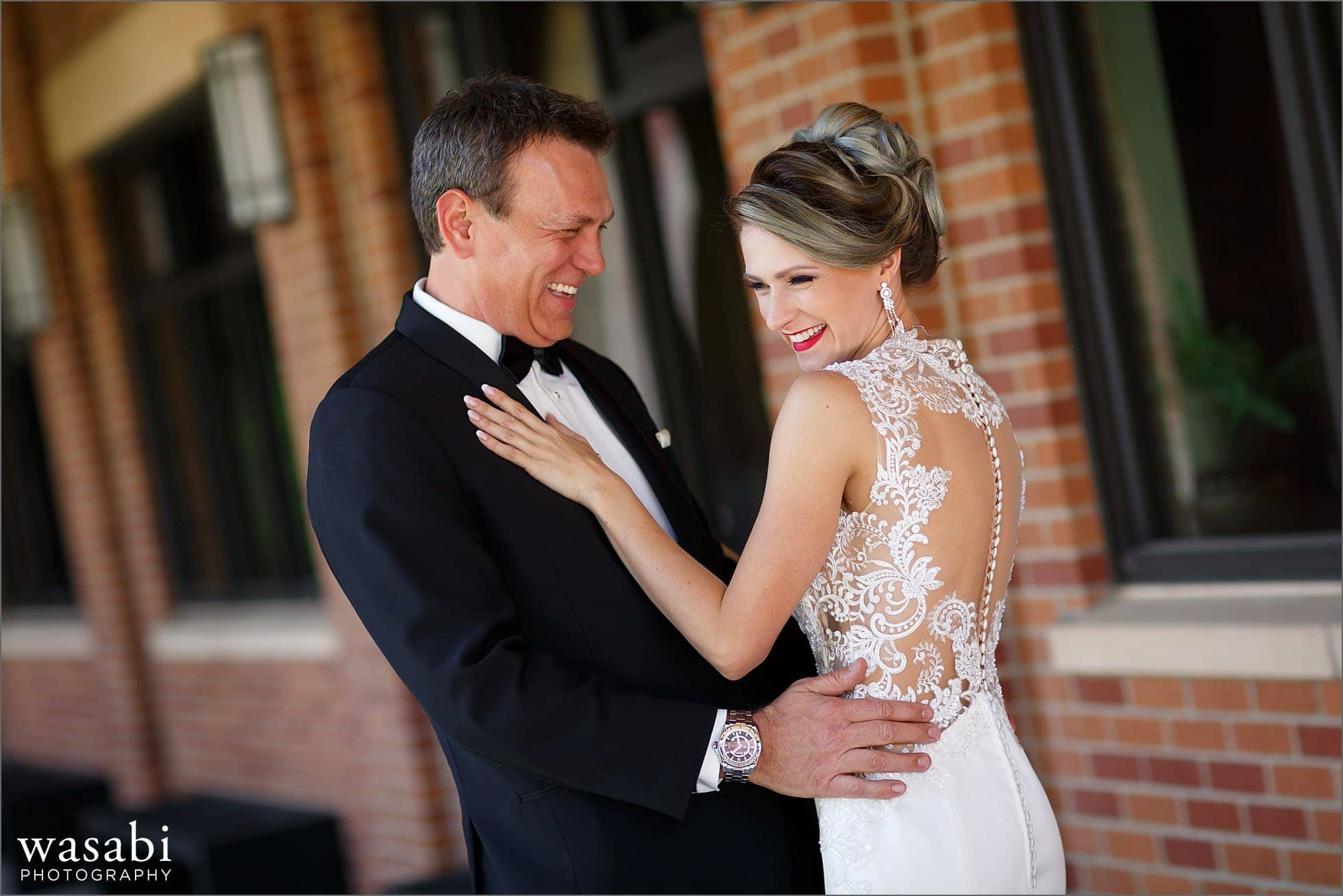 groom laughs with bride during first look before their wedding ceremony at Calvary Church in downtown Golden Colorado