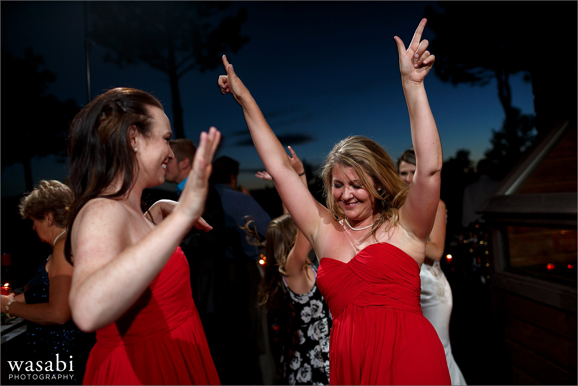 outdoor dancing photos at dusk during wedding reception at a private estate on Lookout Mountain in Golden Colorado