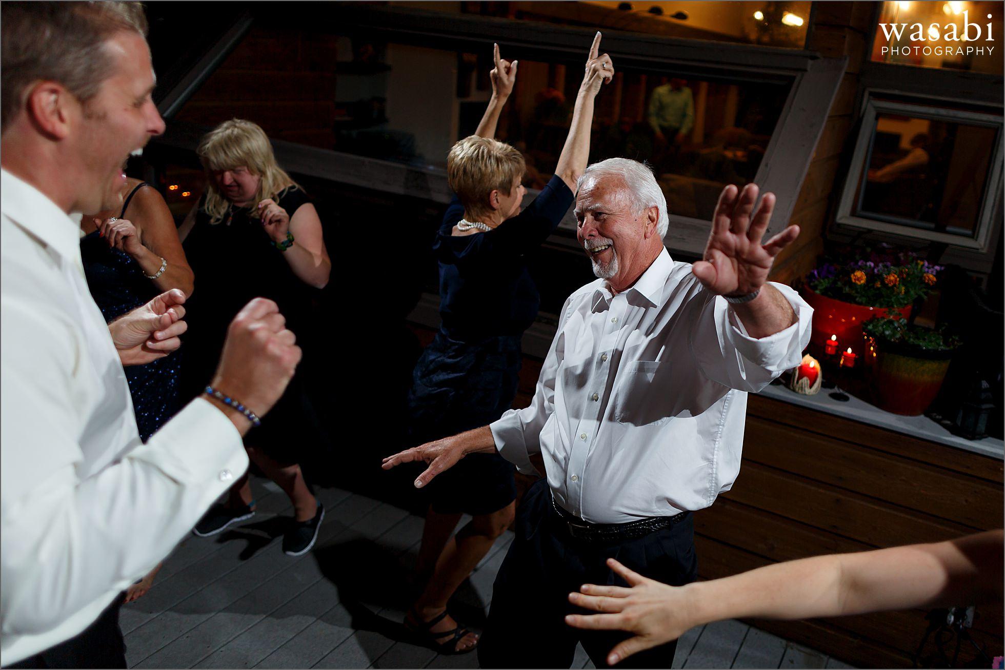 outdoor dancing photos during wedding reception at a private estate on Lookout Mountain in Golden Colorado