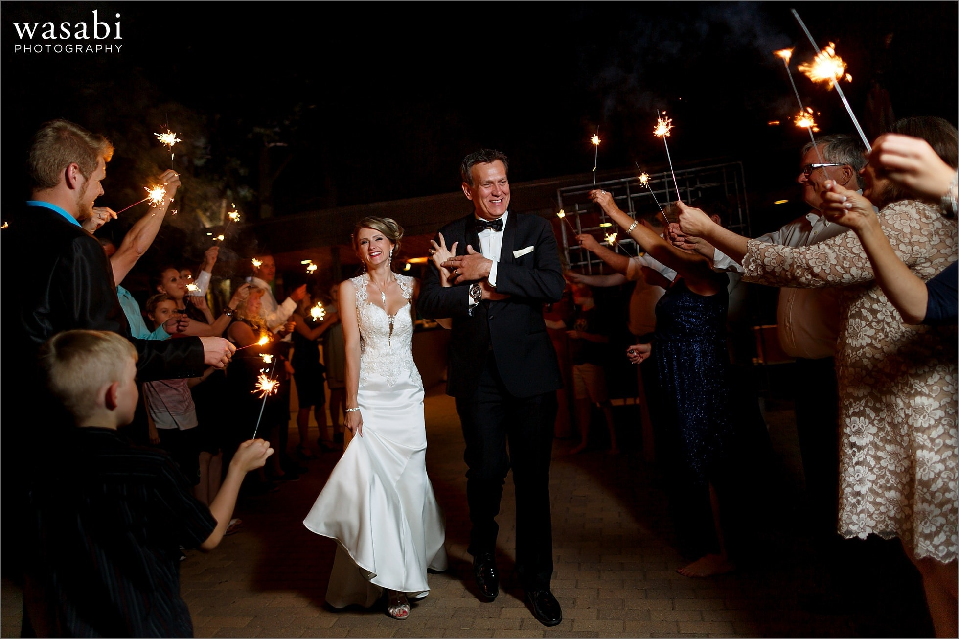 wedding couple bride and groom leave with a sparkler exit after wedding reception