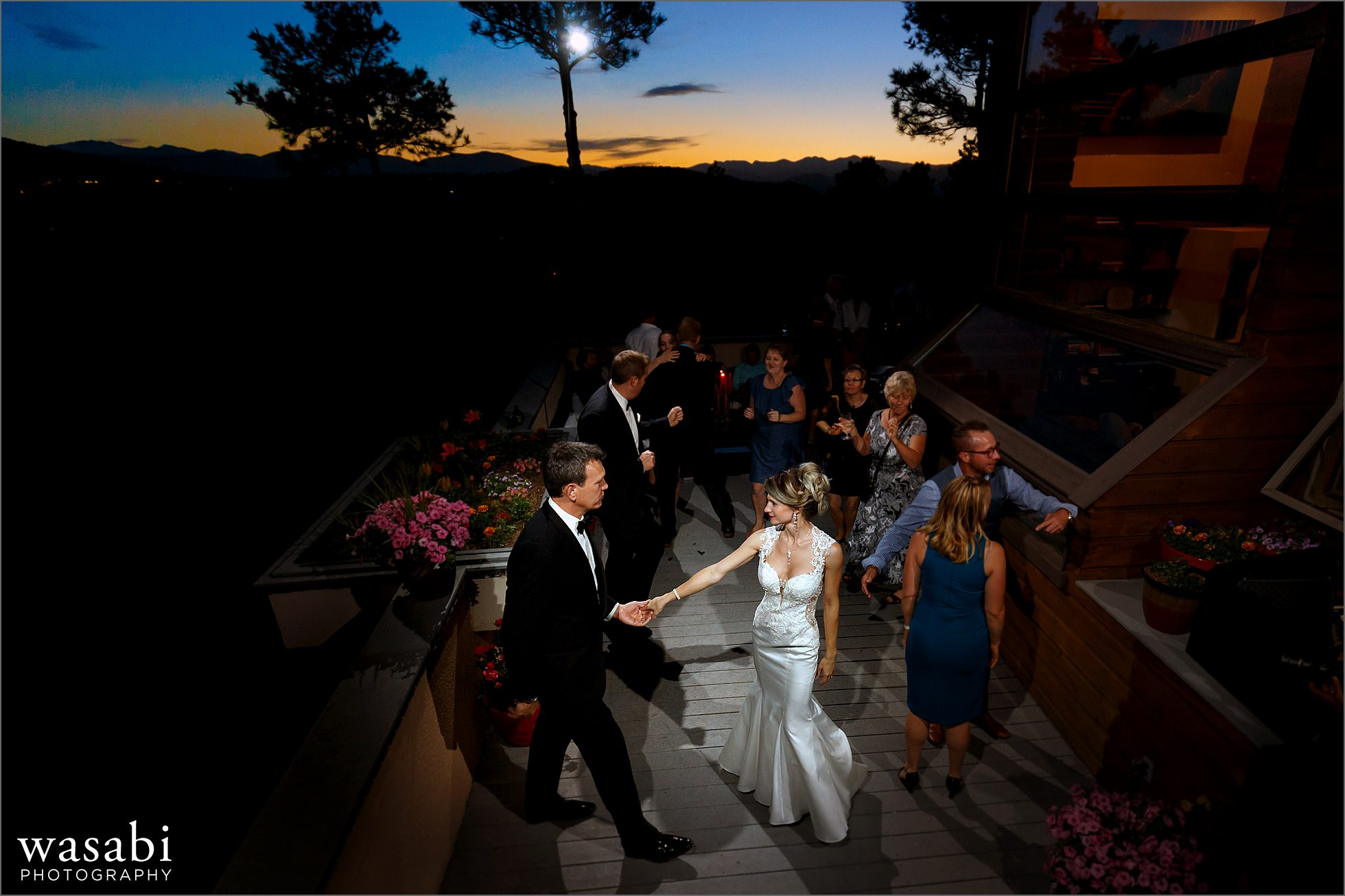 wide angle first dance at sunset during wedding reception at couples home on Lookout Mountain in Golden Colorado