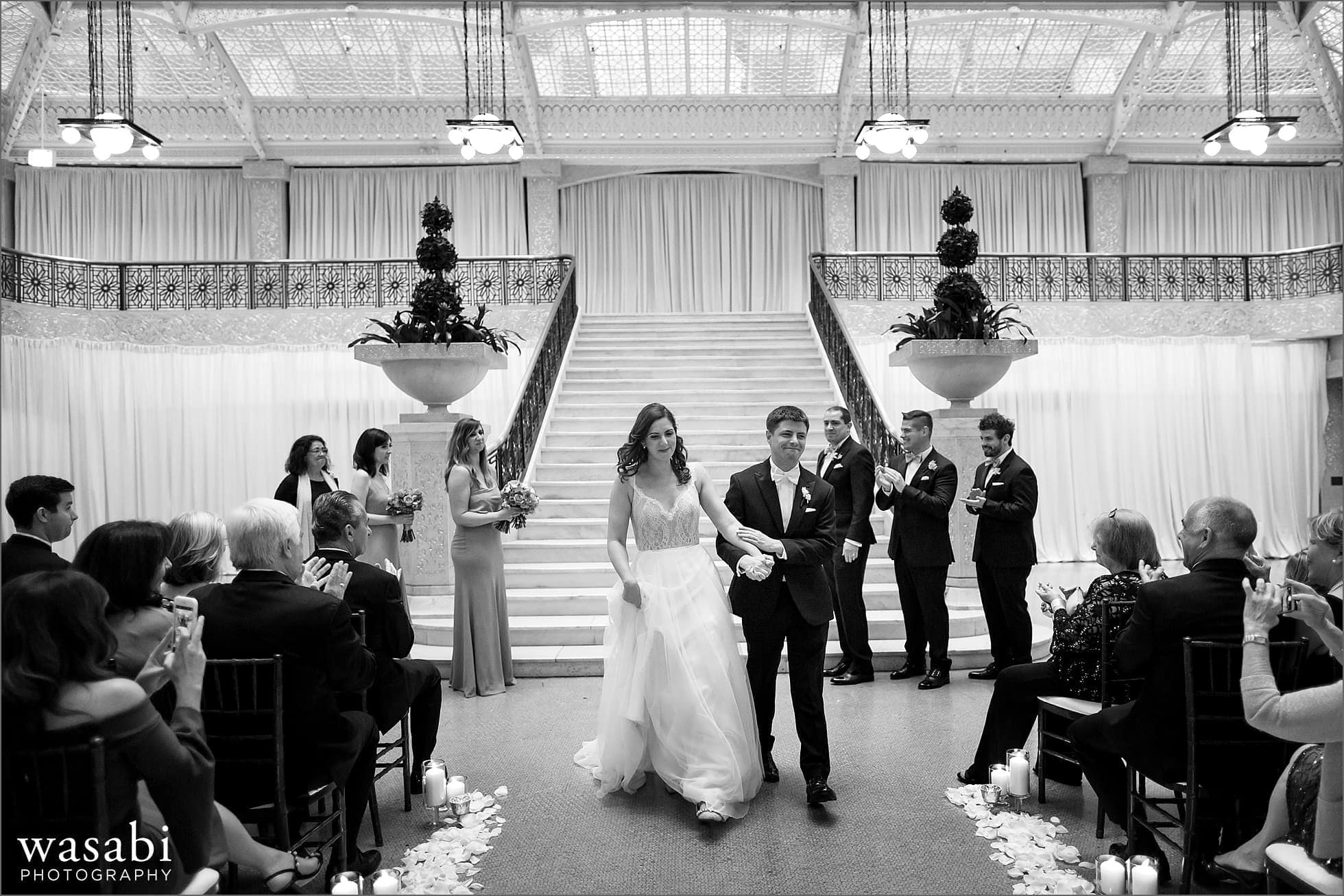 The Rookery Building wedding photos with bride and groom walking back down the aisle after their wedding ceremony at The Rookery Building in Chicago