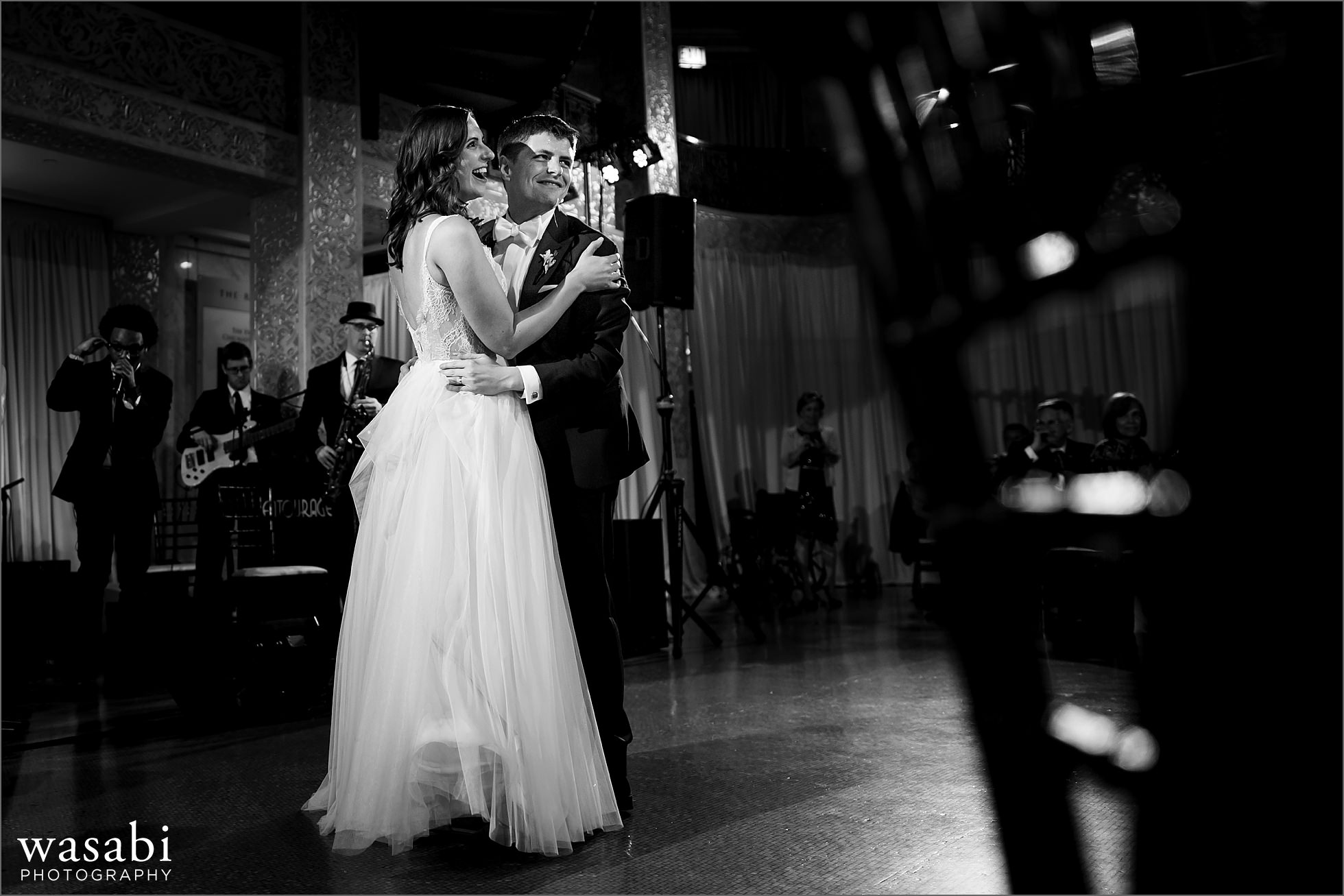 black and white bride and groom first dance during wedding reception at The Rookery Building in Chicago