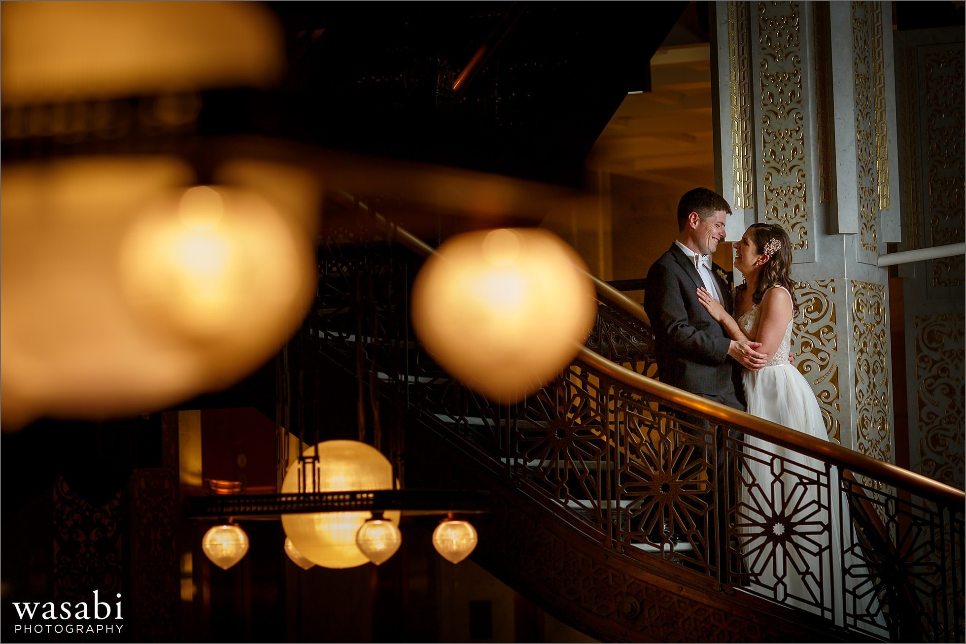 bride and groom pose for portait on the stairs of The Rookery Building