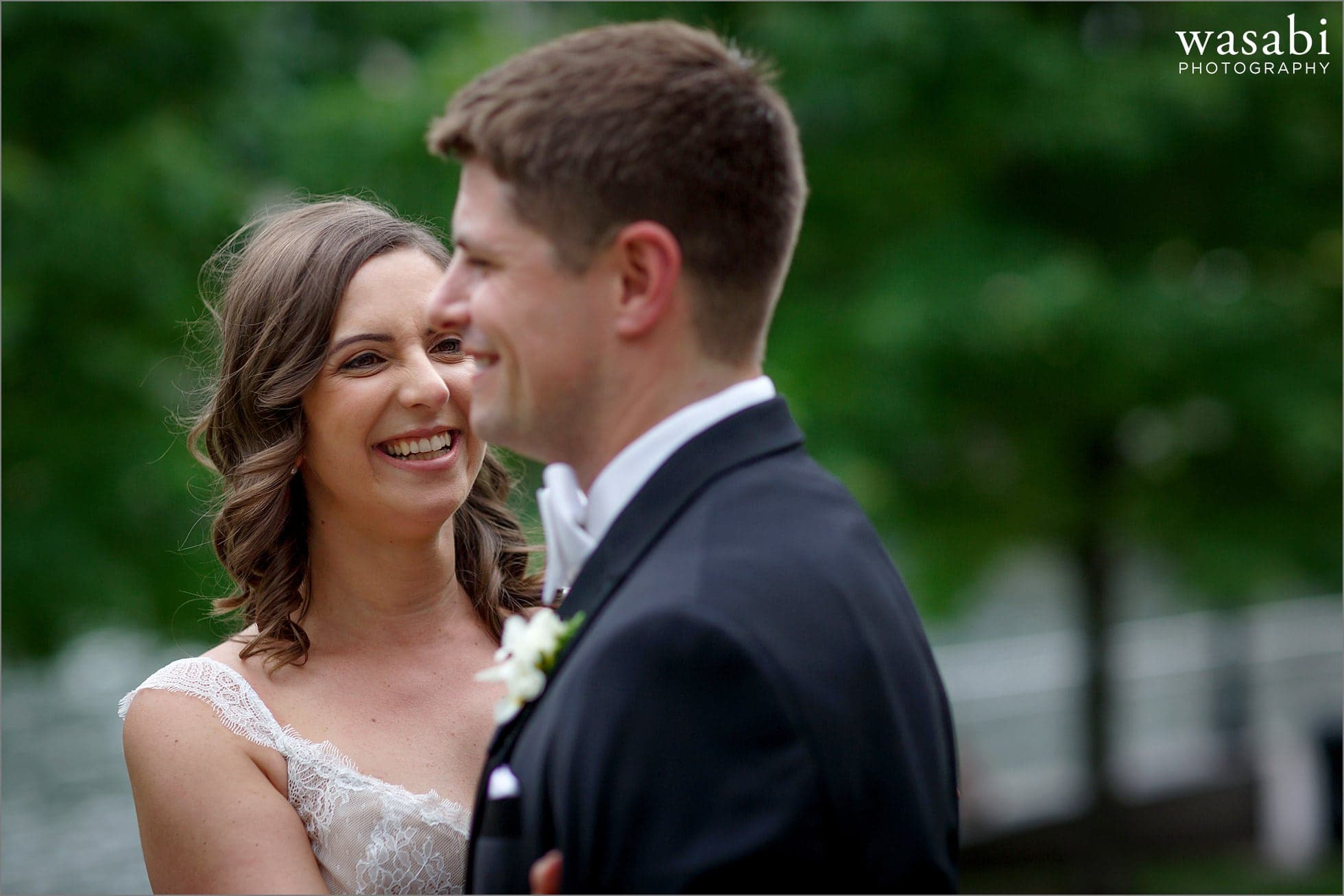 bride reacts after seeing her groom during first look at Chicago riverwalk with ivy in the background