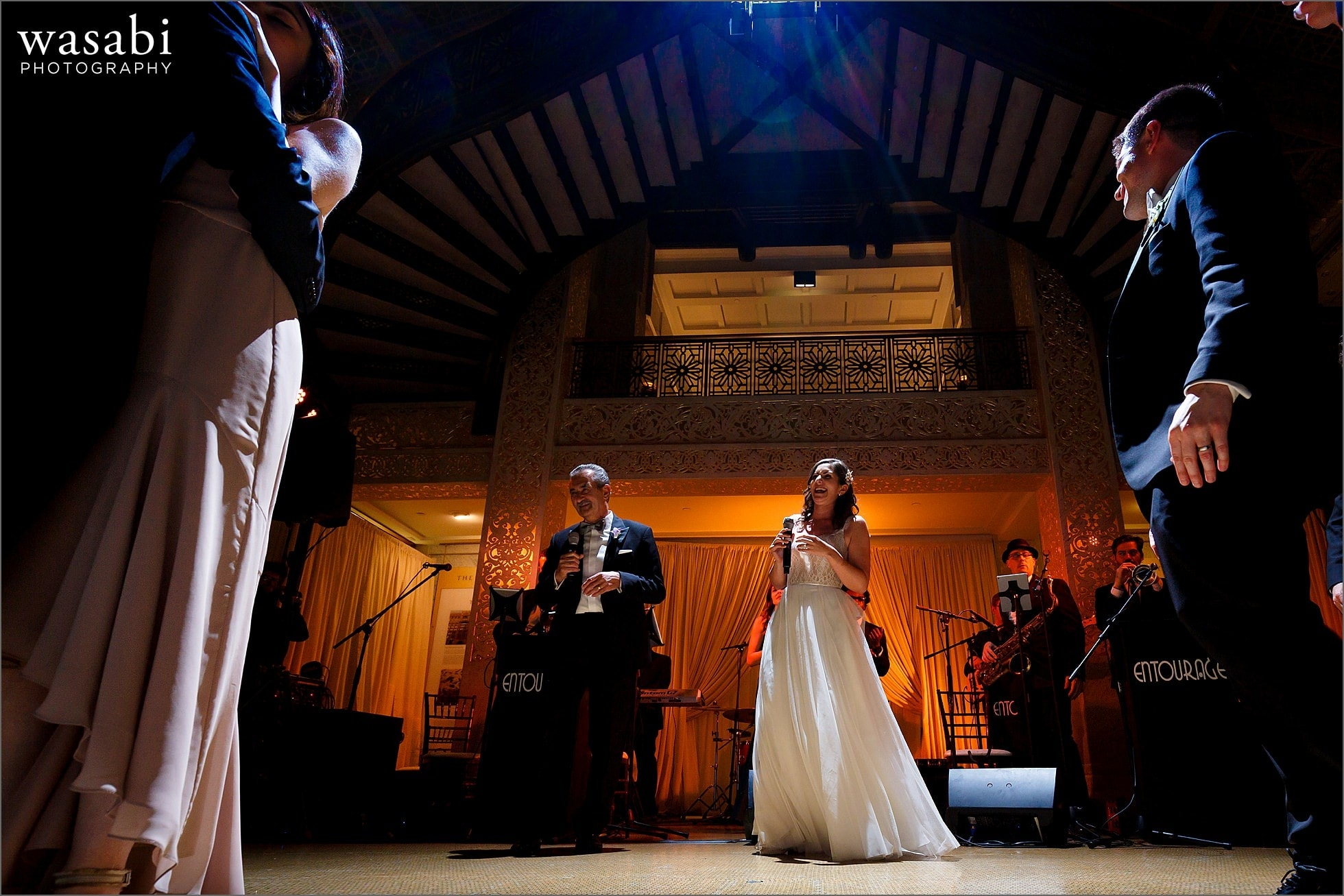 groom and father sing a duet for their first dance during wedding reception at The Rookery Building in Chicago