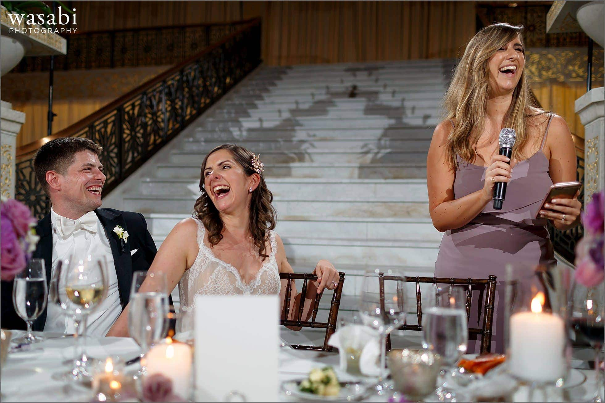 maid of honor toast speech with bride and groom laughing during wedding reception at The Rookery Building in Chicago