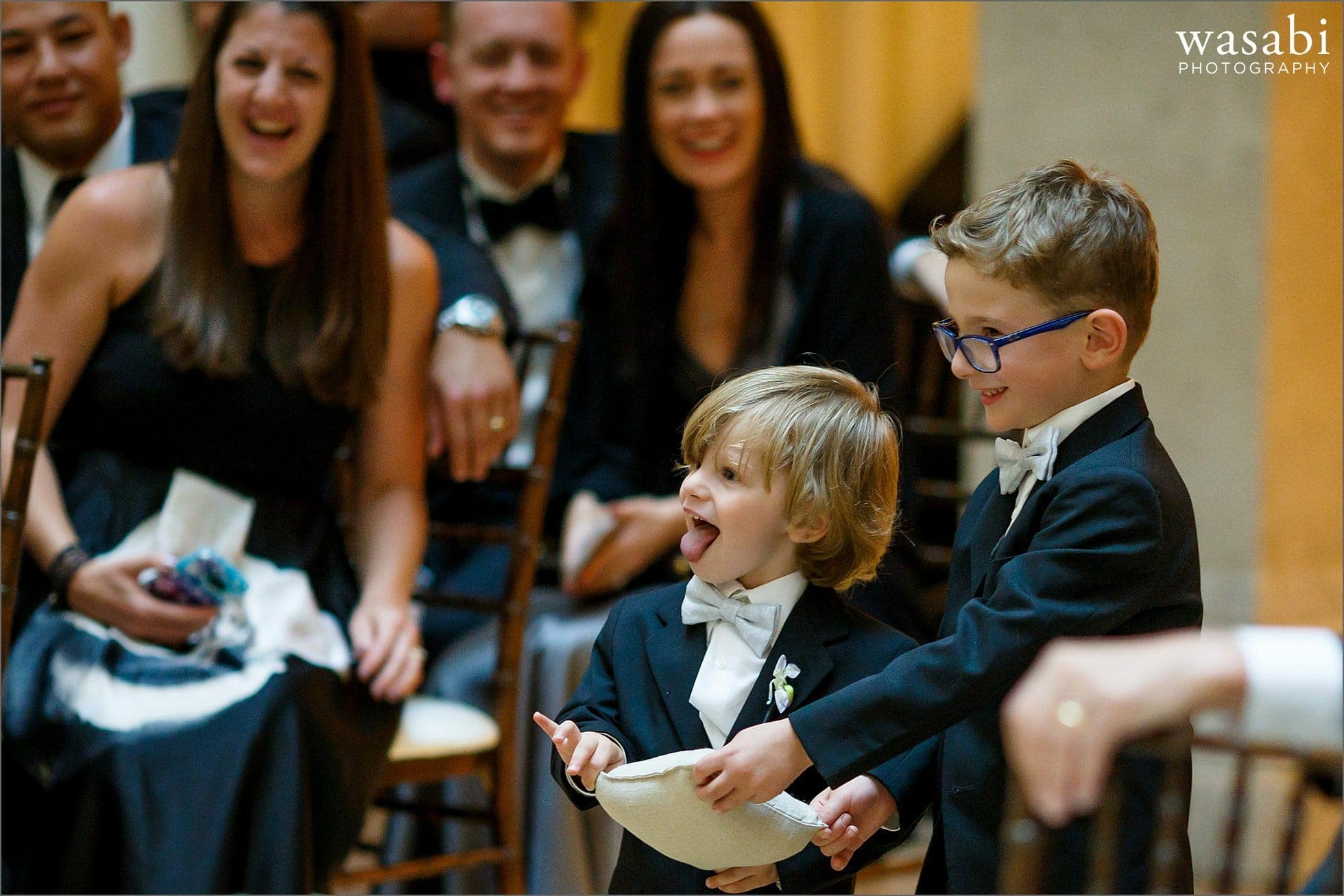 ring bearers carry the wedding rings in before wedding ceremony at The Rookery Building in Chicago