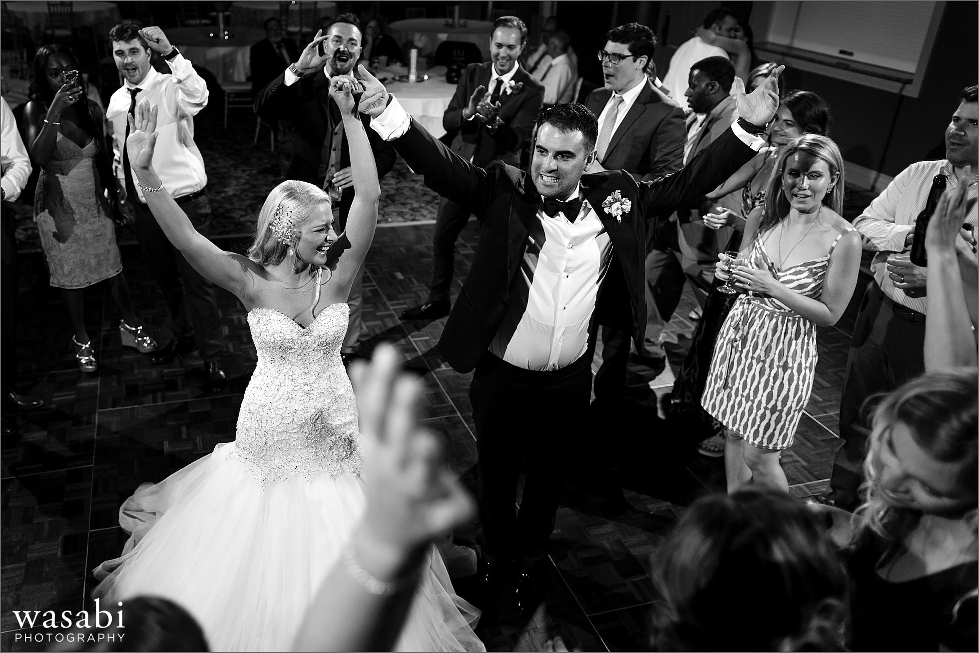 black and white bride and groom dance in the center of a circle during last song at their Crystal Tree Country Club in Orland Park wedding reception