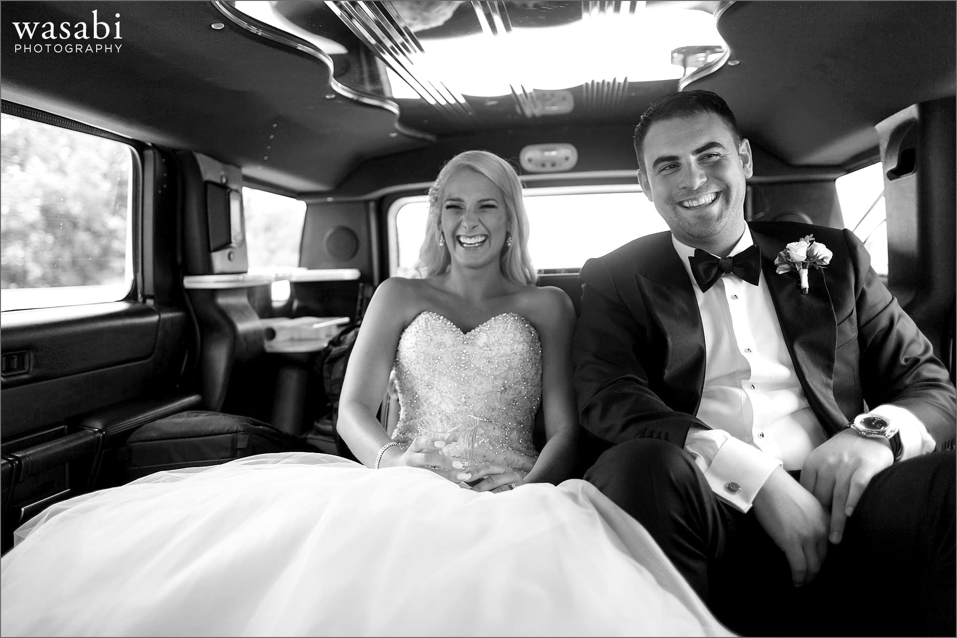 bride and groom ride in limo on their way to their wedding at Crystal Tree Country Club in Orland Park