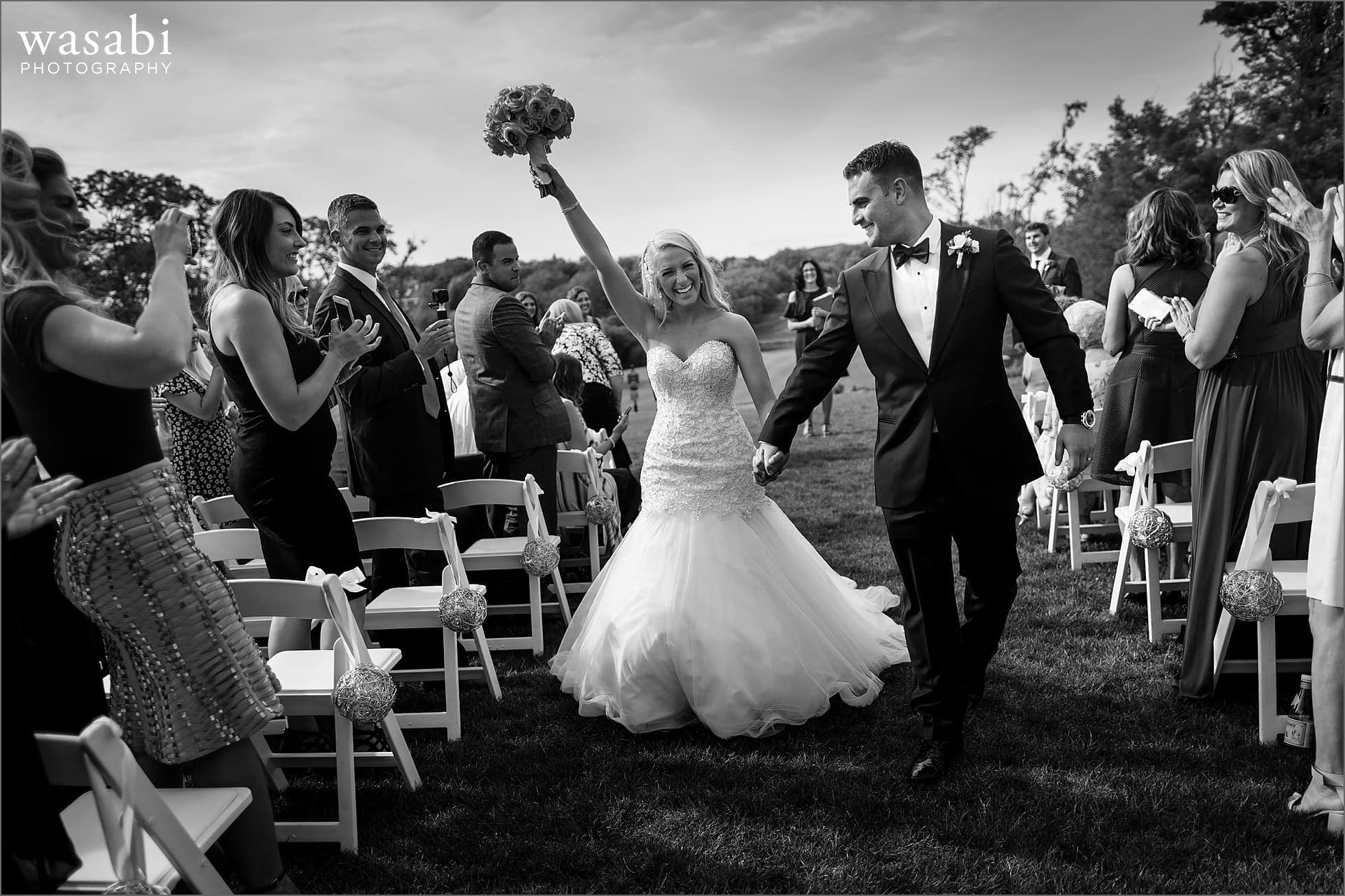 bride and groom walk back down aisle after outdoor ceremony Crystal Tree Country Club in Orland Park wedding photos
