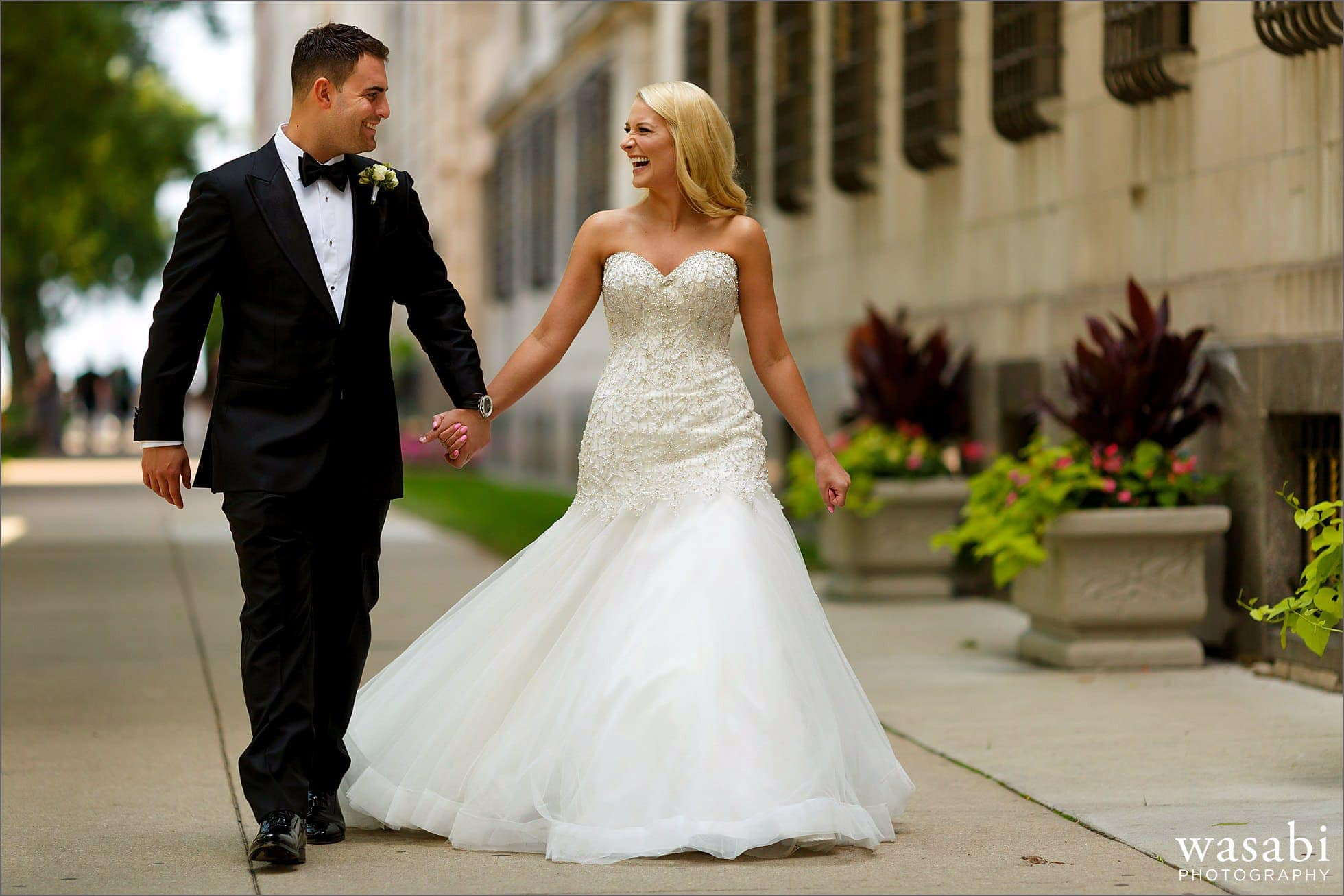 bride and groom walk down sidewalk before their wedding at Drake Hotel in Chicago