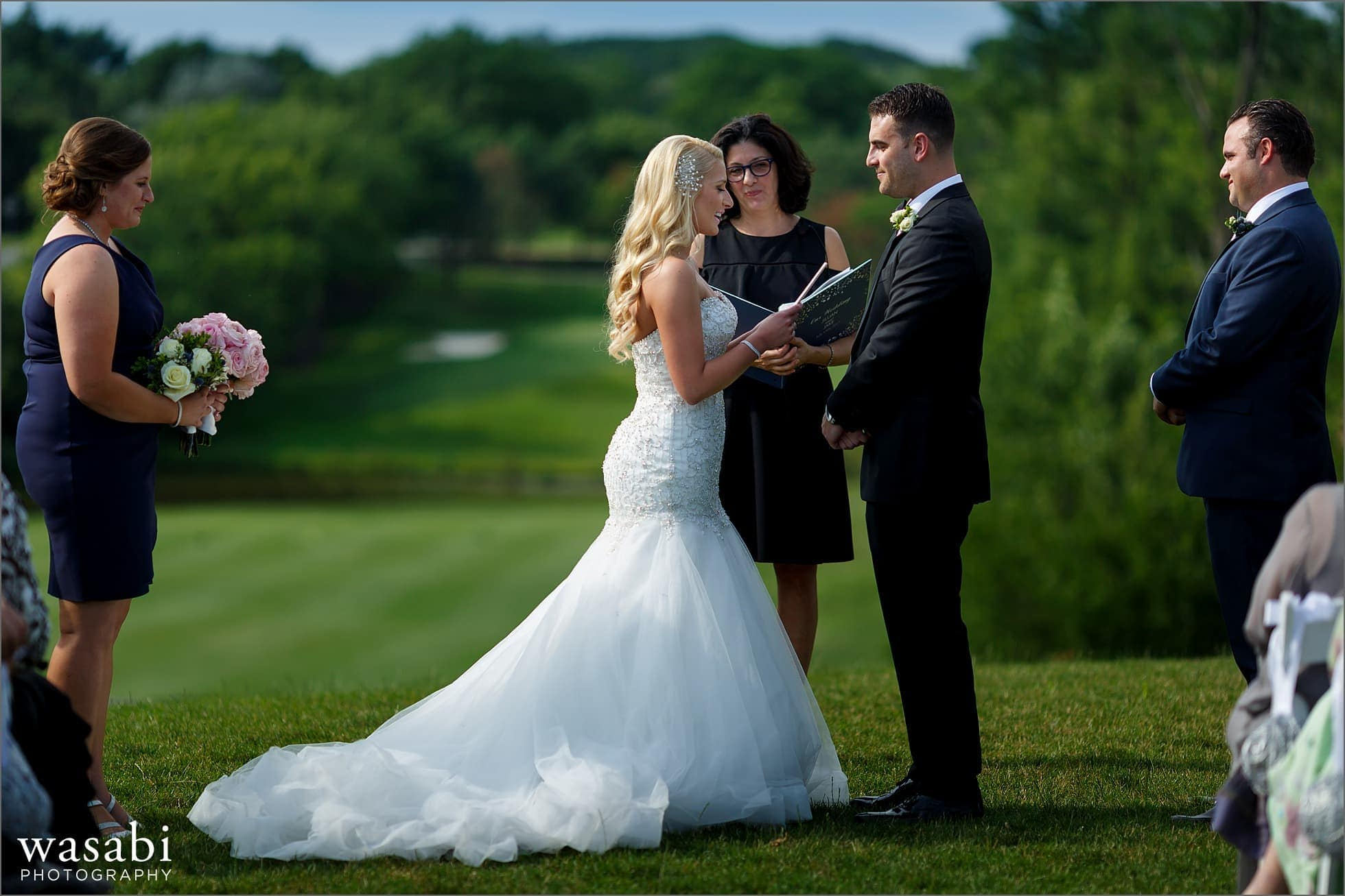 bride reads vows during outdoor wedding ceremony at Crystal Tree Country Club in Orland Park