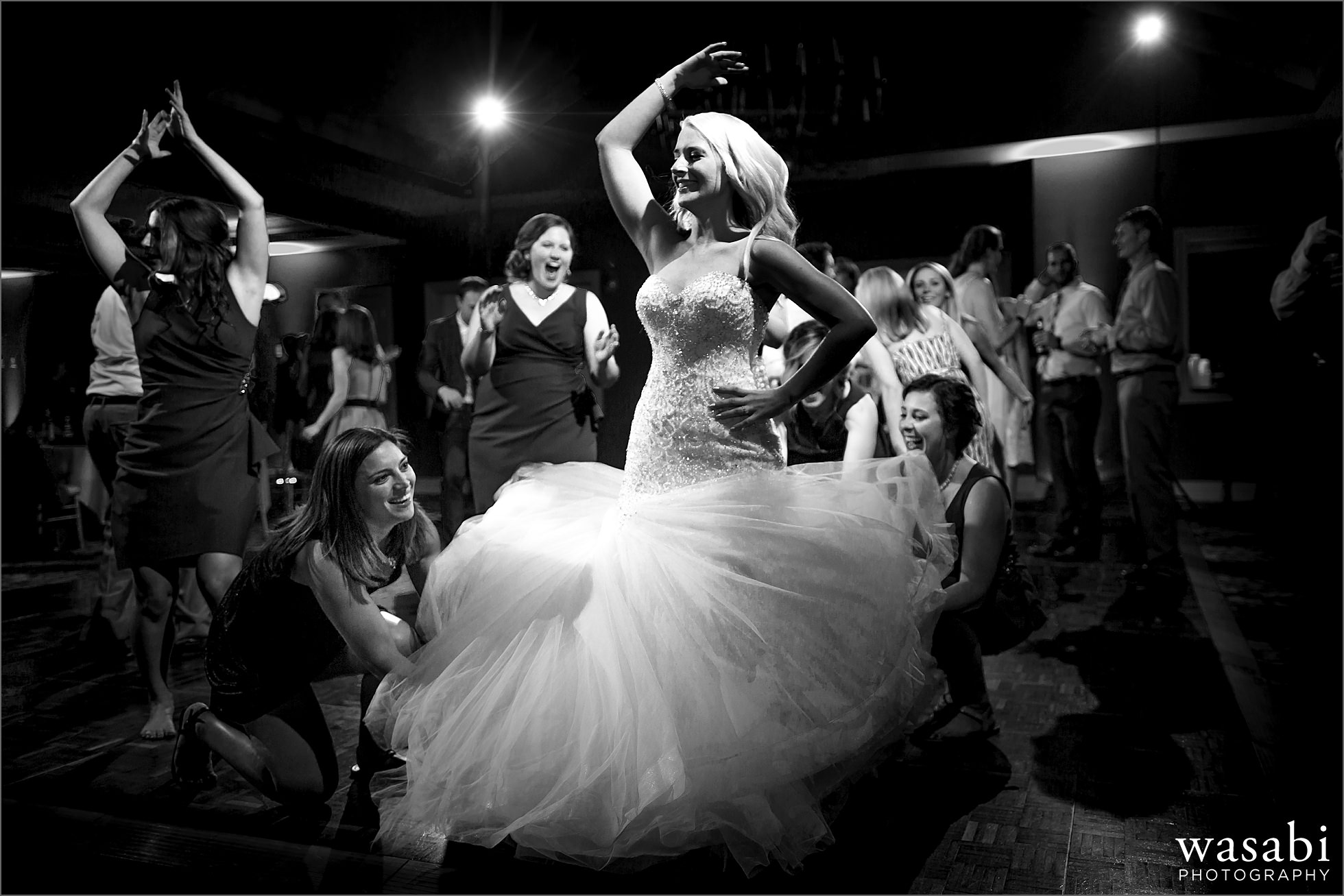 bride spins with wedding dress flare during wedding reception at Crystal Tree Country Club in Orland Park