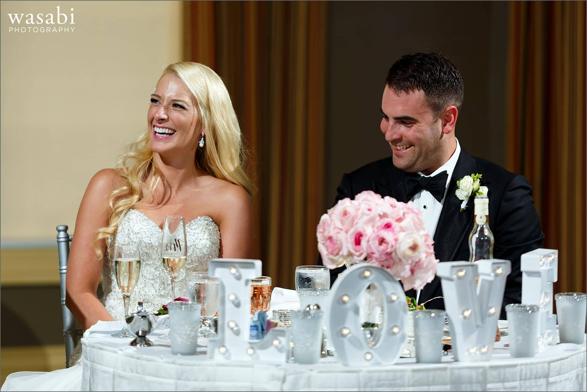 couple reacts during toast at Crystal Tree Country Club in Orland Park reception photos