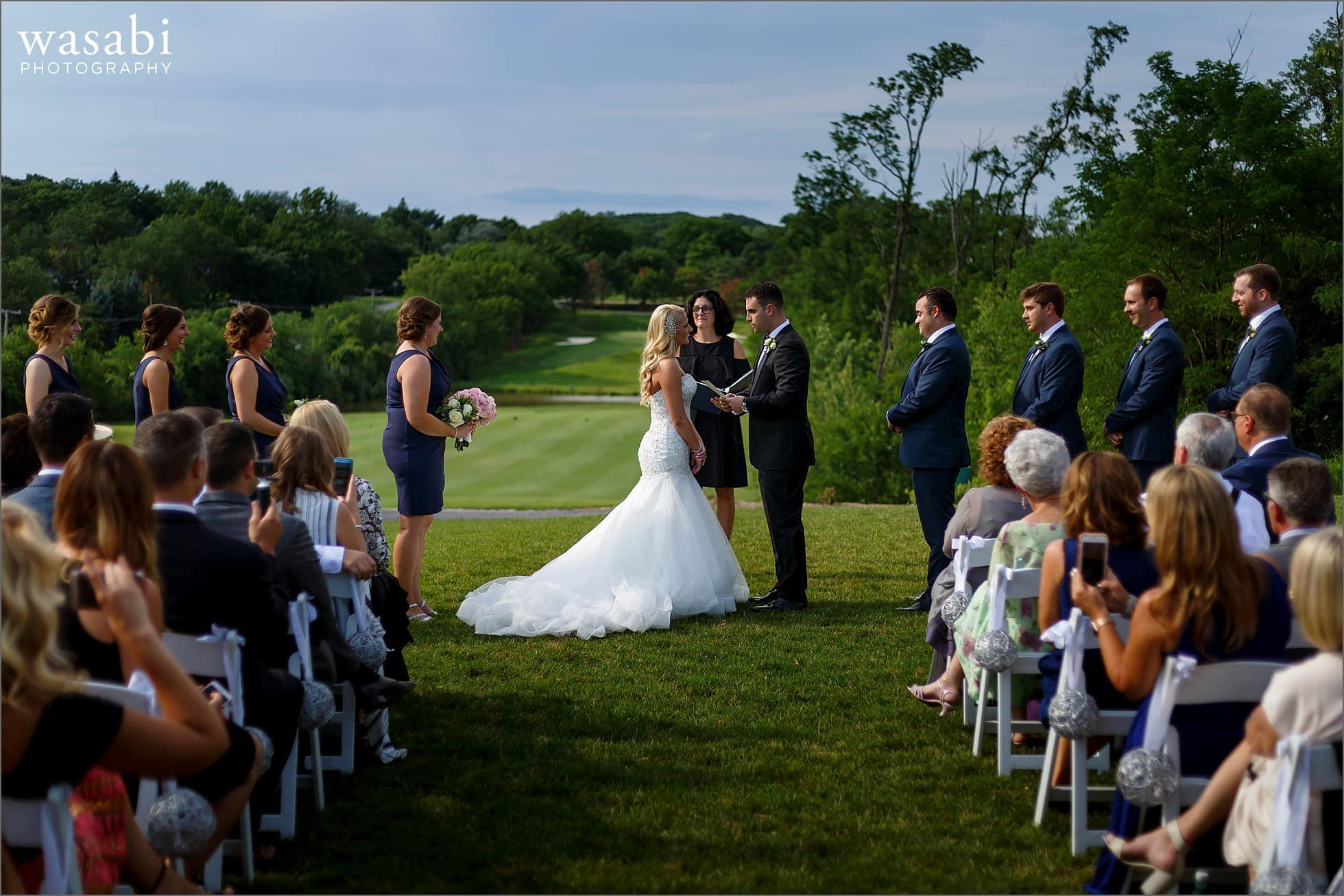 wide angle view of outdoor ceremony golf course wedding at Crystal Tree Country Club in Orland Park