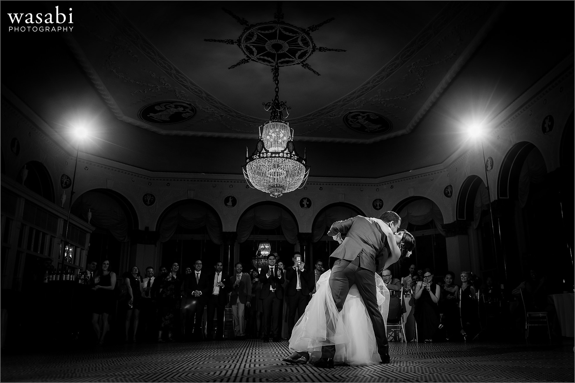 black and white bride and groom dip first dance during South Shore Cultural Center wedding photos