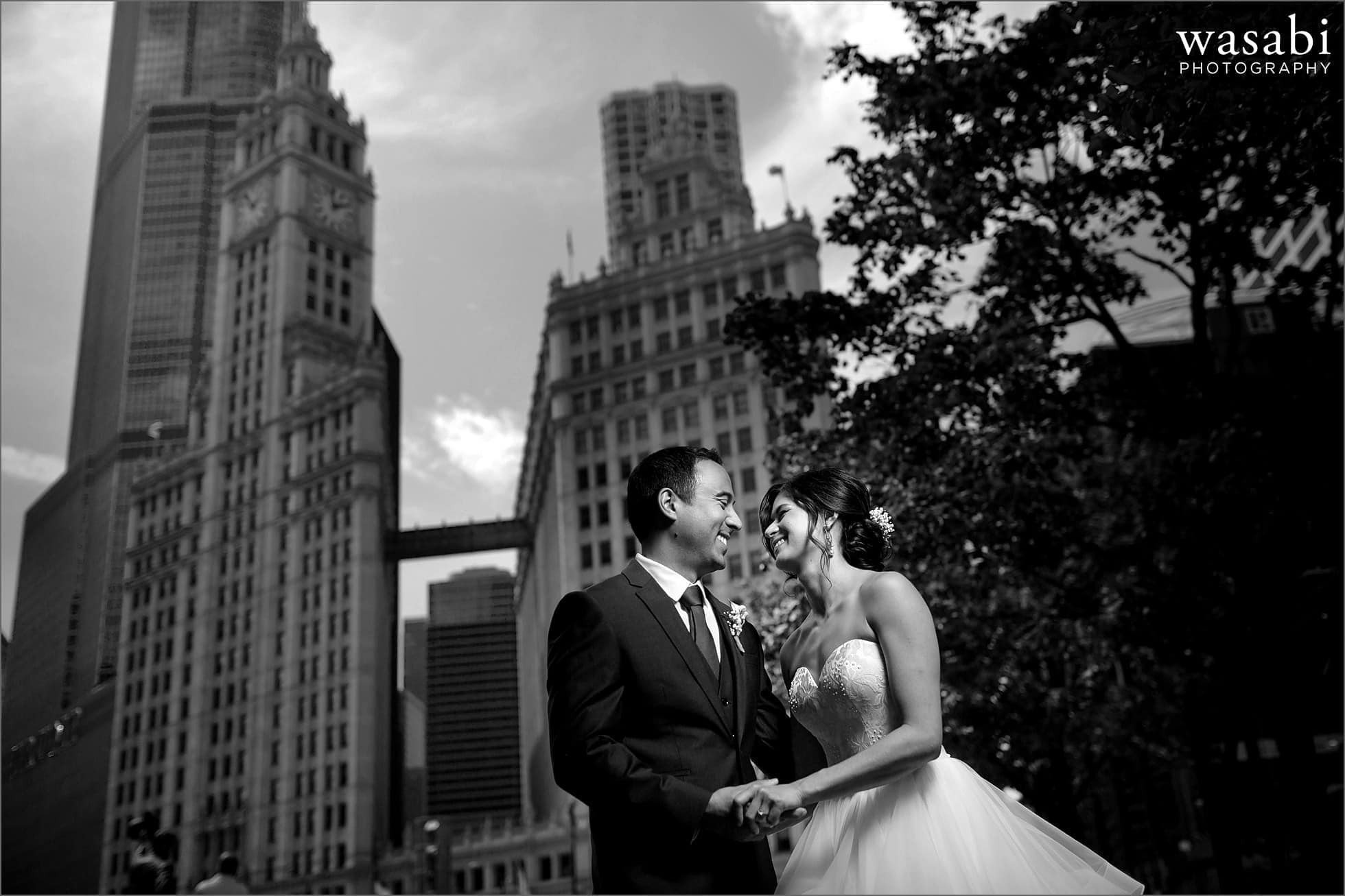 black and white bride and groom wedding portrait in front of Wrigley building in downtown Chicago
