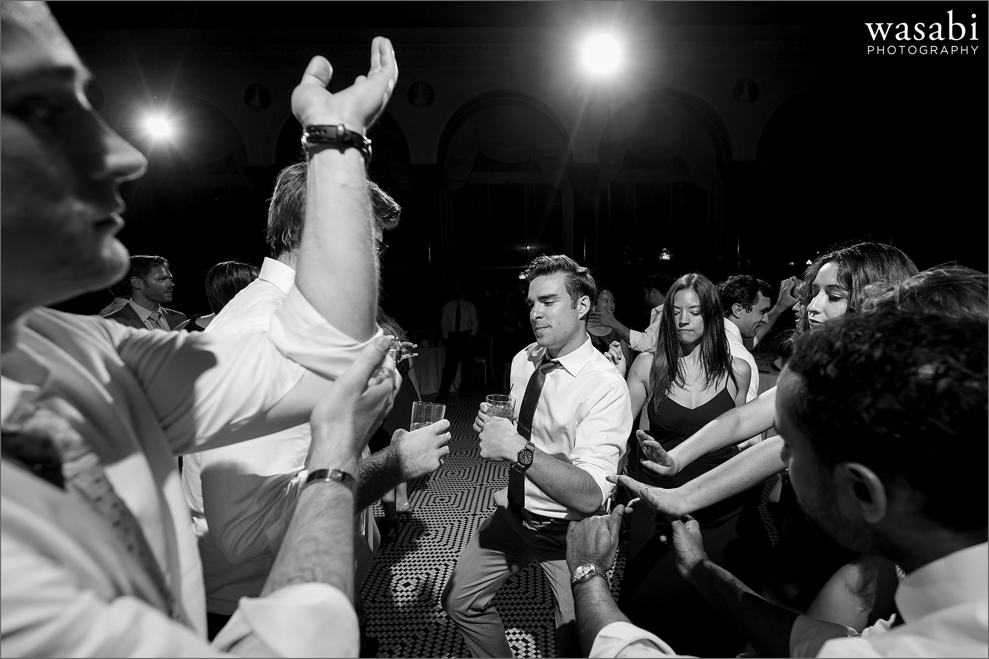 black and white guests dance during wedding reception at South Shore Cultural Center