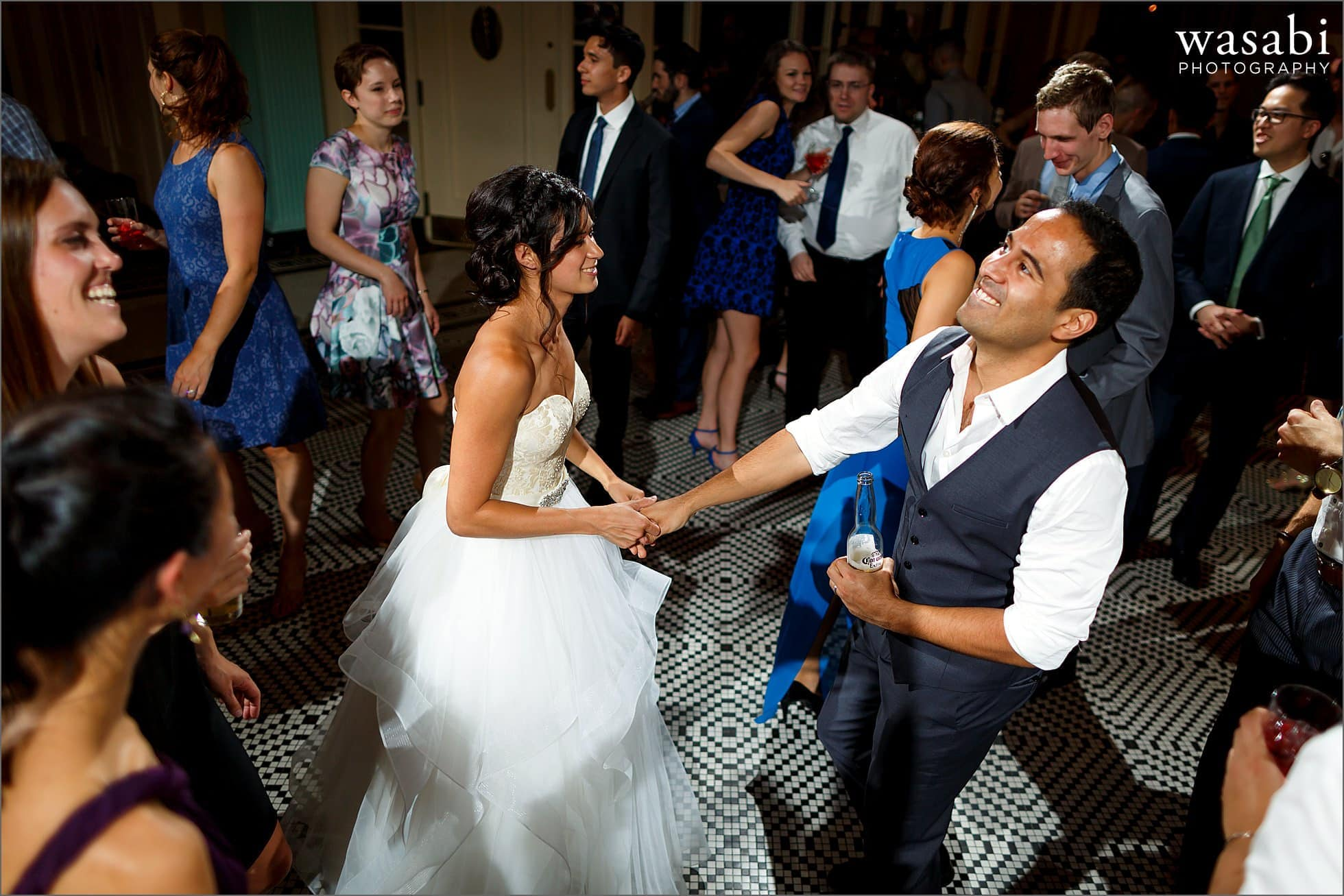 bride and groom dance together in center of guests during South Shore Cultural Center wedding reception