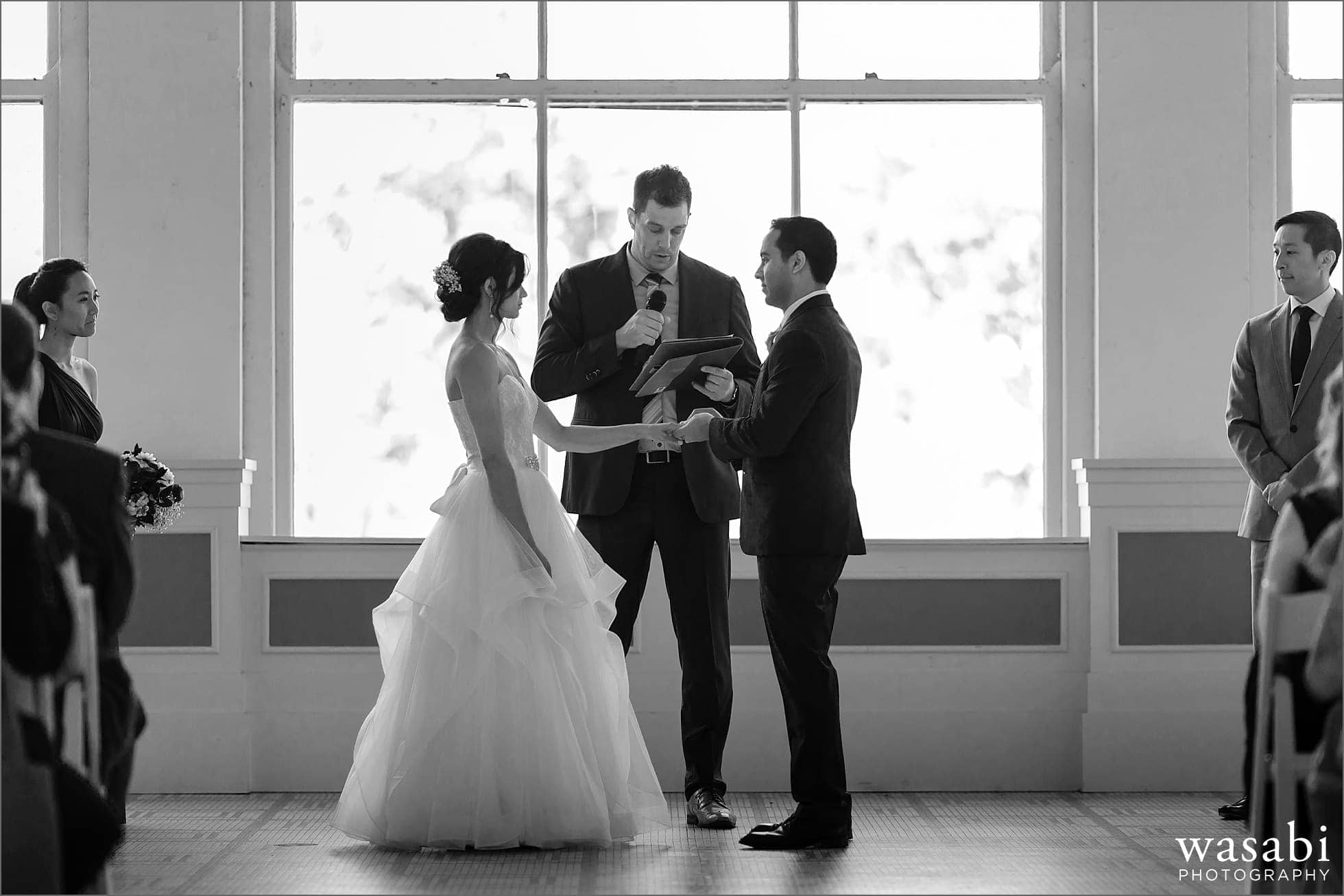 bride and groom exchange rings during South Shore Cultural Center wedding photos