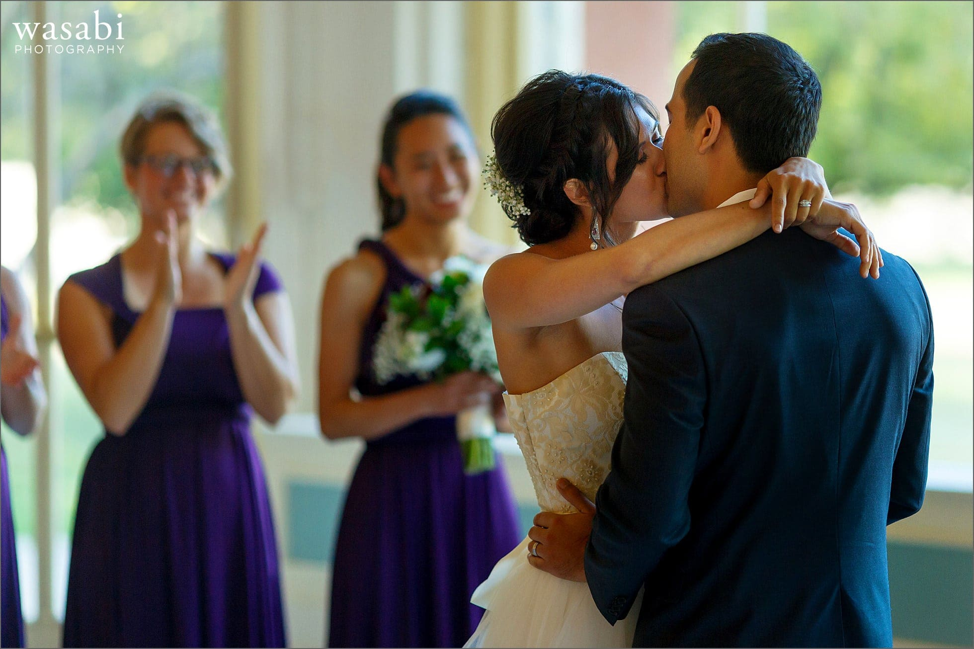 bride and groom kiss during South Shore Cultural Center wedding photos