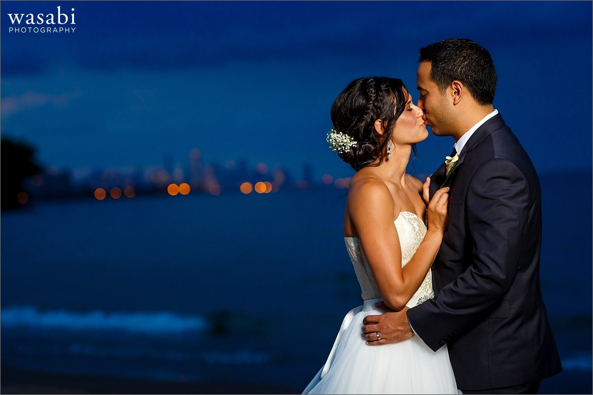bride and groom kiss during night portrait for South Shore Cultural Center wedding photos