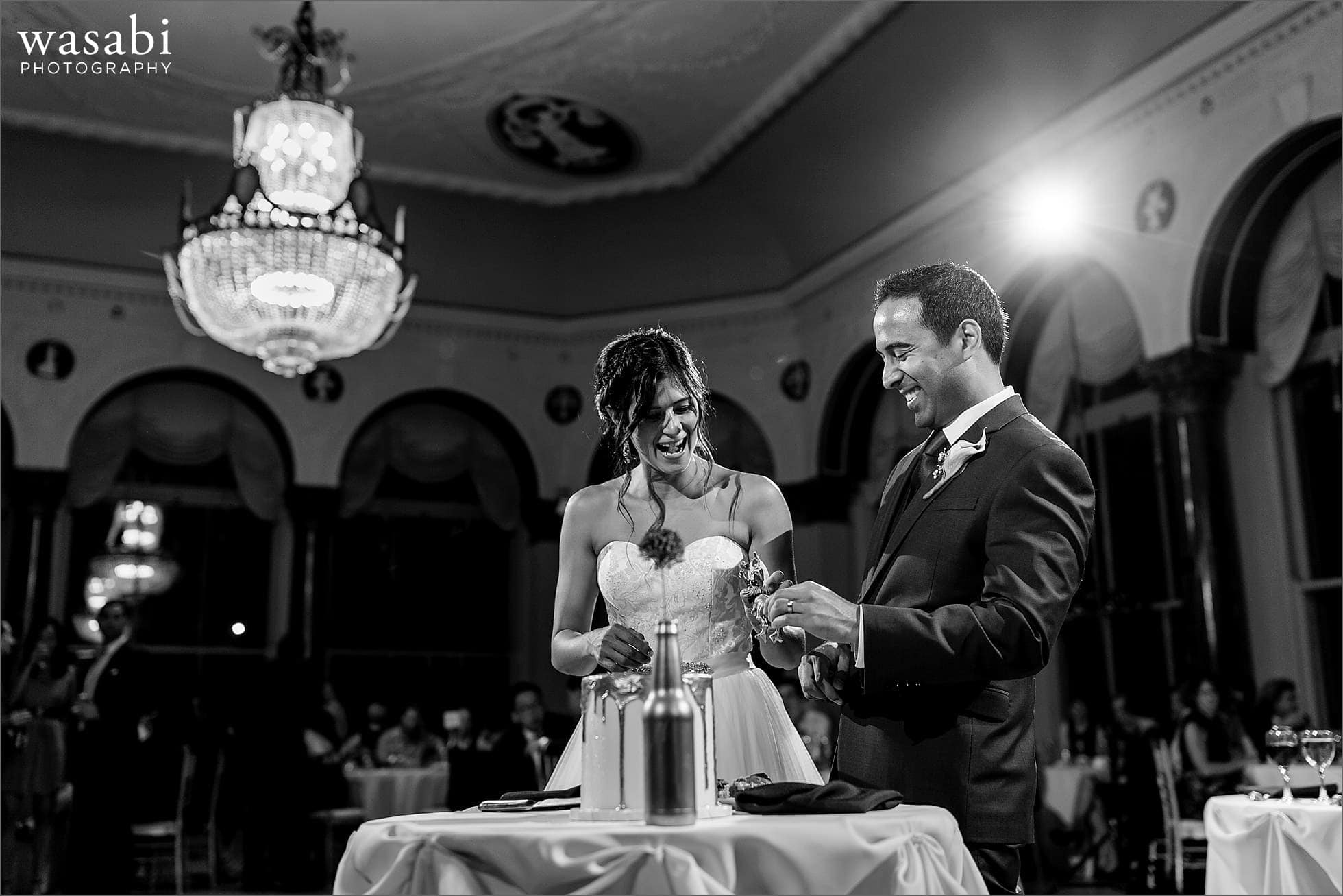 bride and groom laugh after cutting cake