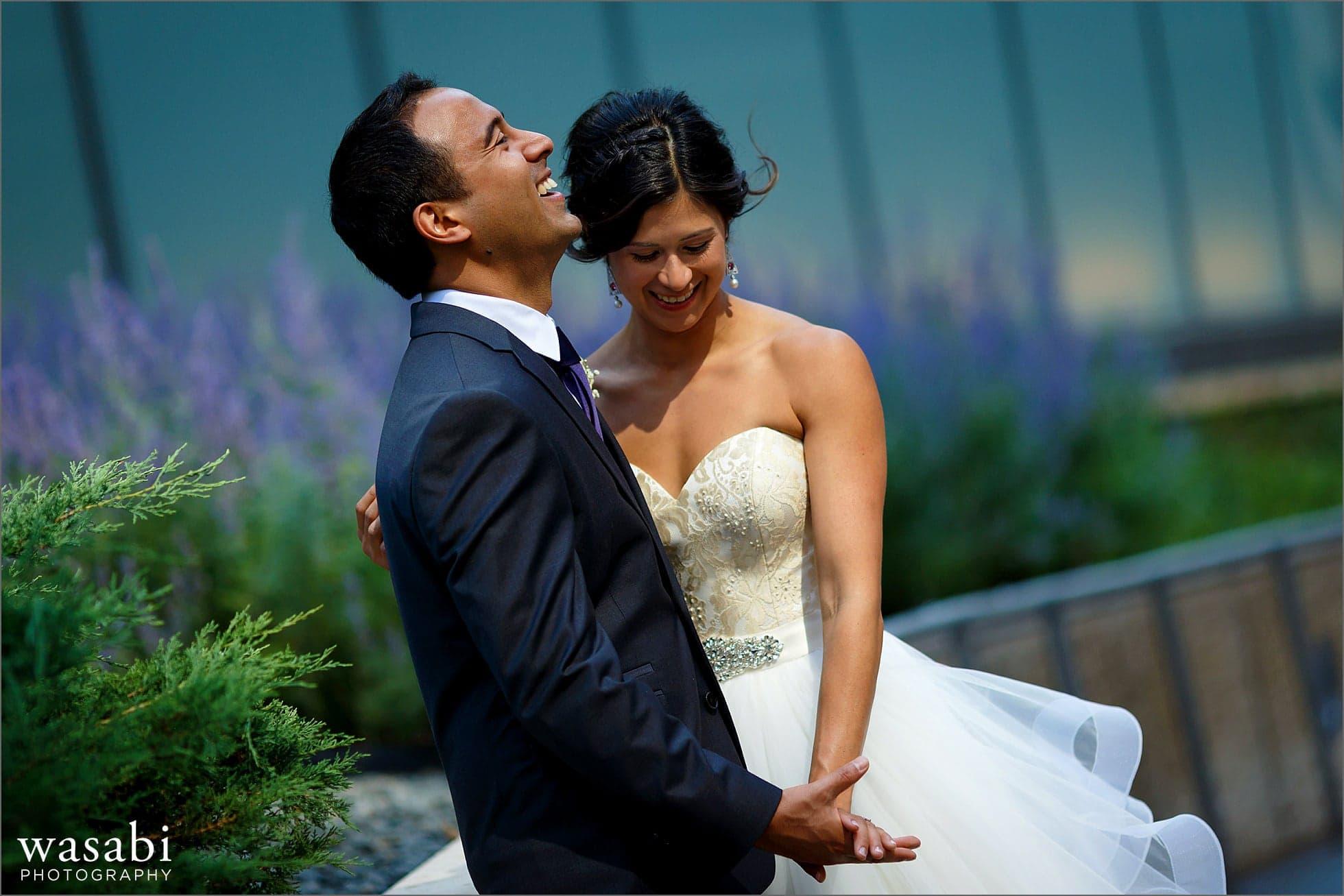 bride and groom laugh outdoor garden wedding portrait