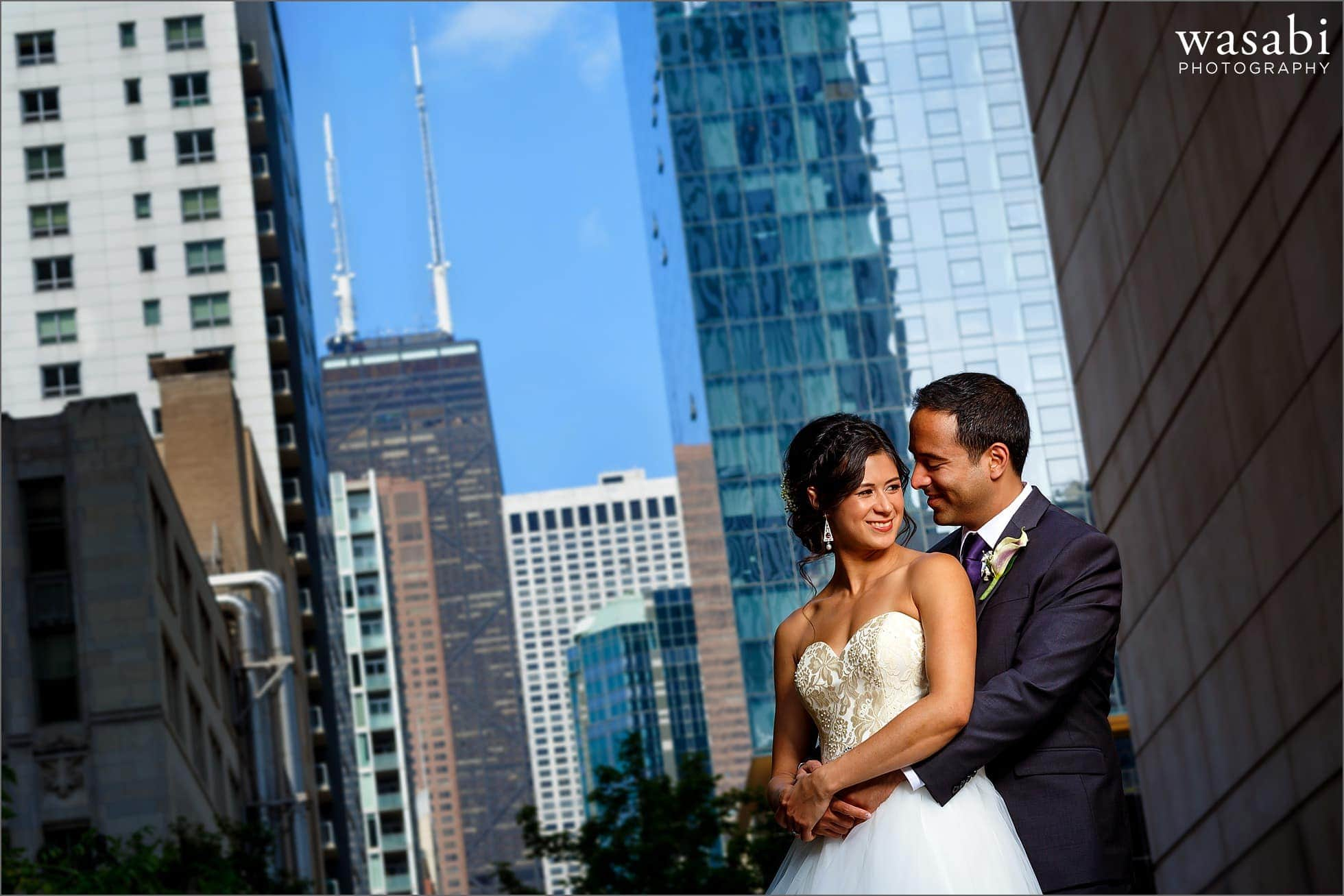 bride and groom wedding lit portrait chicago skyline hancock building
