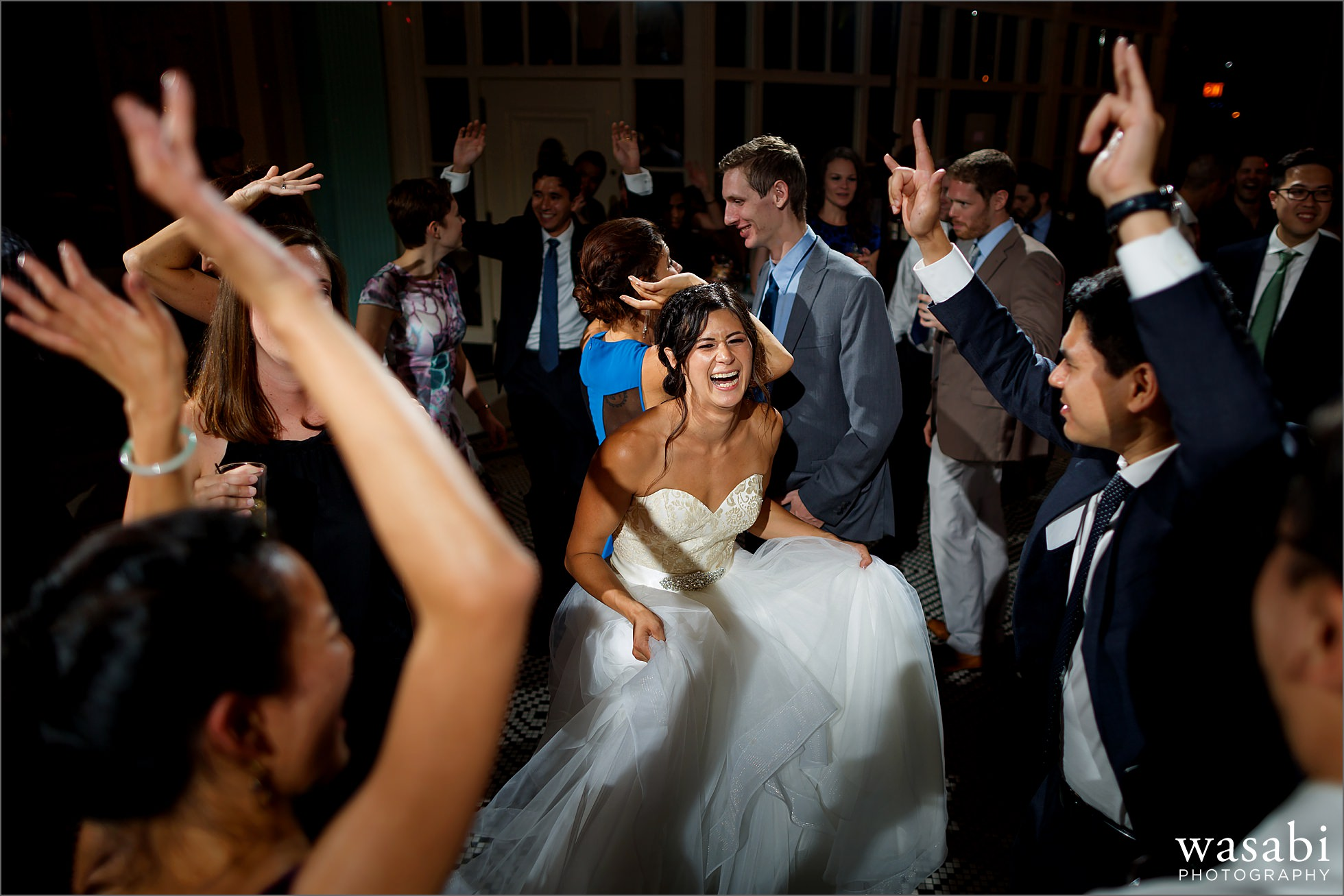 bride dances in the center with guests during South Shore Cultural Center wedding reception photos