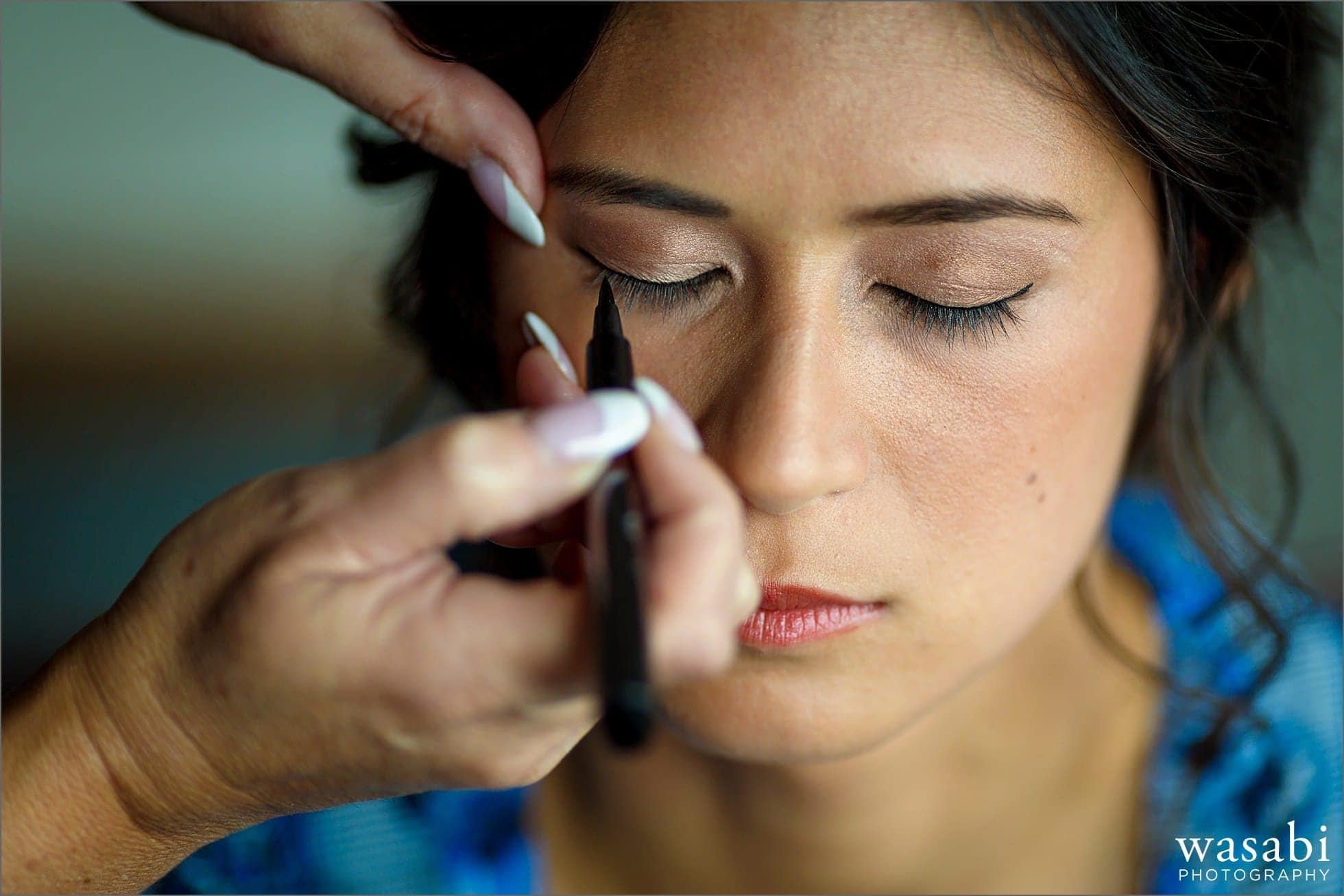 bride has makeup applied while getting ready for her wedding at Sheraton Grand Hotel in Chicago