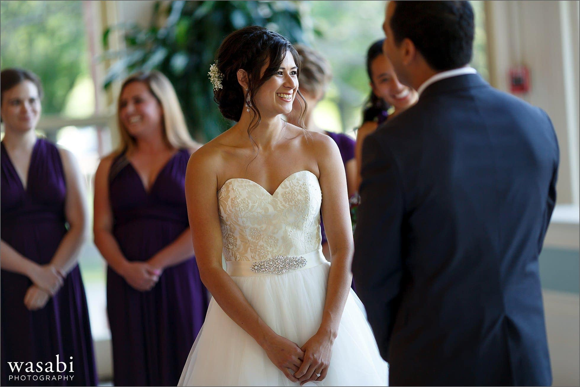 bride laughs during South Shore Cultural Center wedding ceremony in Chicago
