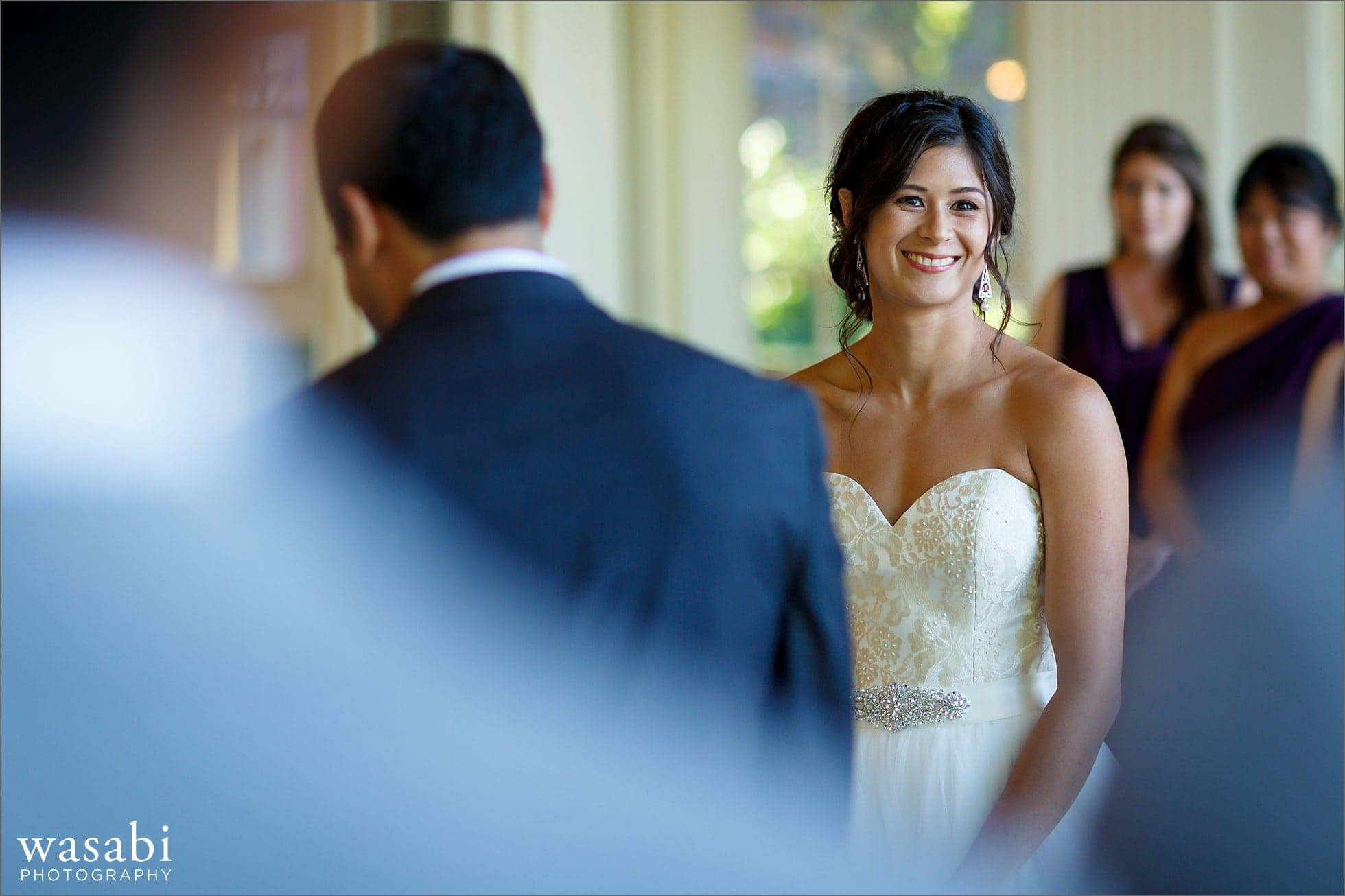 bride laughs during wedding ceremony at South Shore Cultural Center