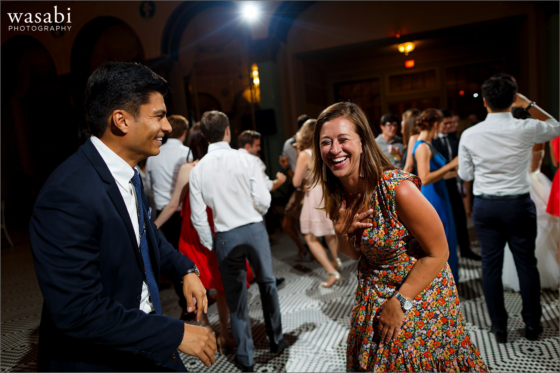 couple laughs on the dance floor during South Shore Cultural Center wedding reception photos