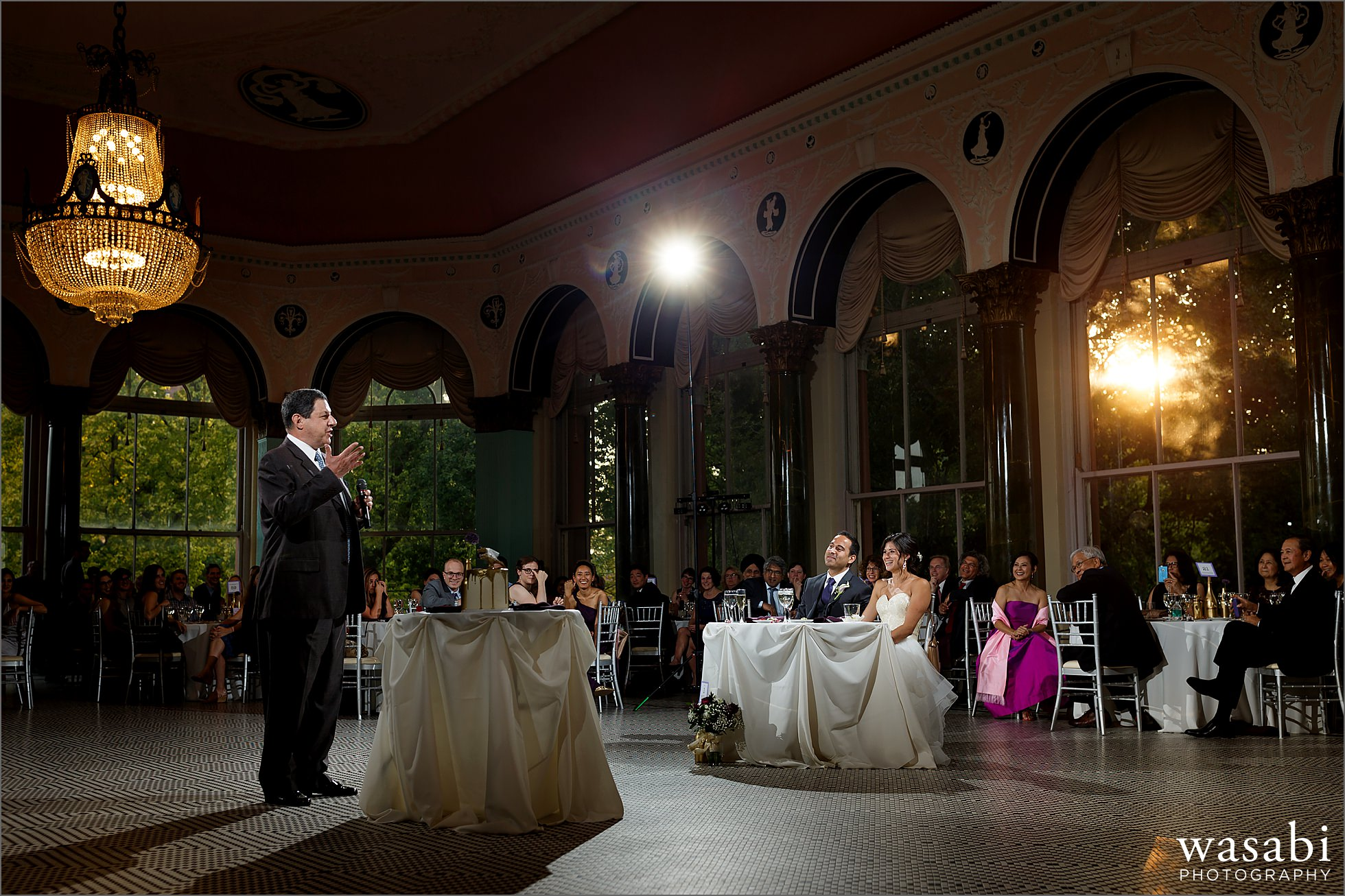 father of the bride delivers toast during wedding reception at South Shore Cultural Center