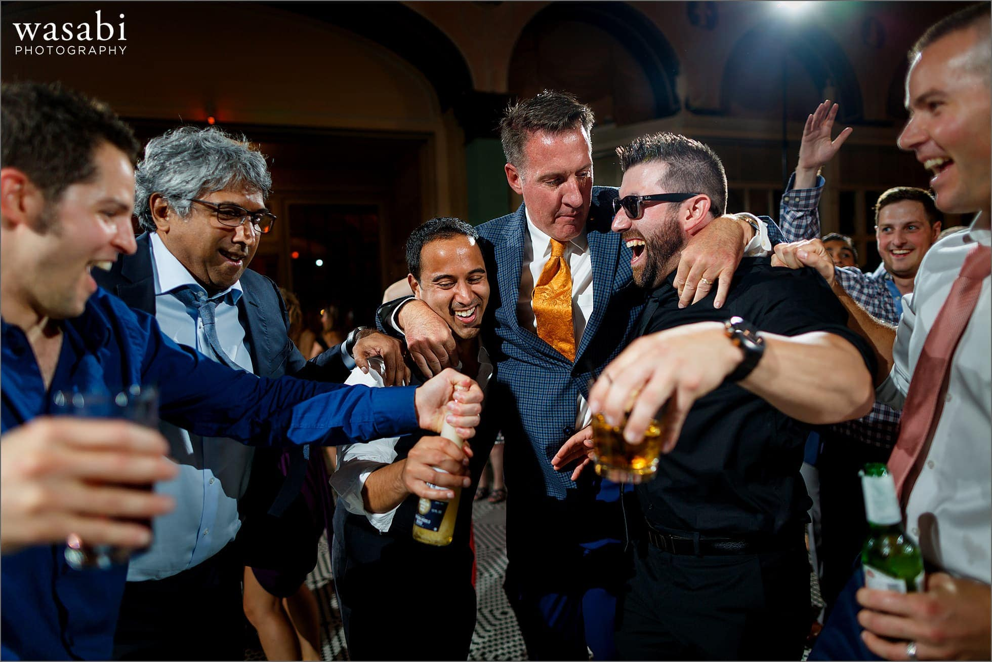 groom dances with friends during South Shore Cultural Center wedding reception photos