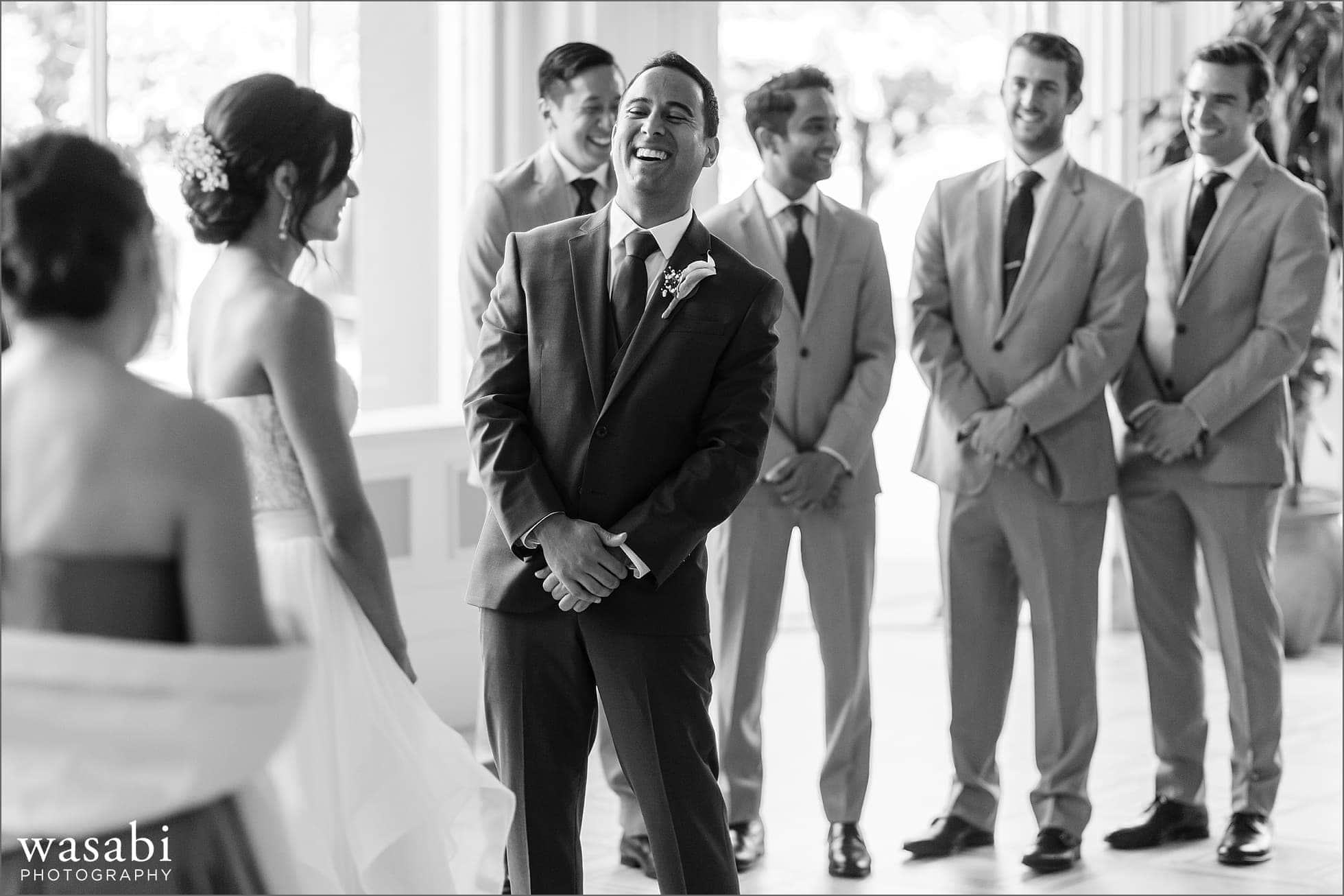 groom laughs during wedding ceremony at South Shore Cultural Center