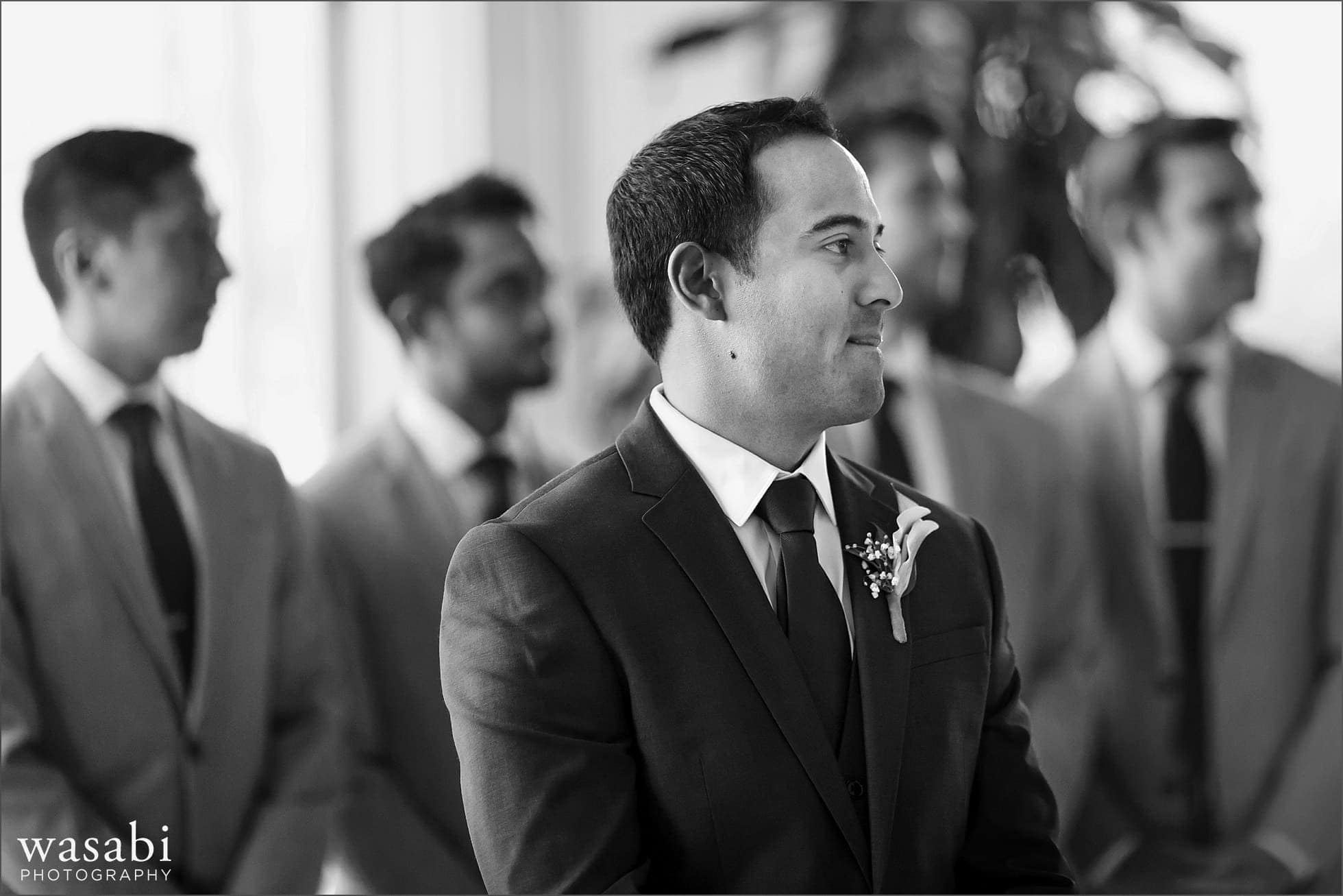 groom reaction to bride walking down aisle during wedding ceremony at South Shore Cultural Center