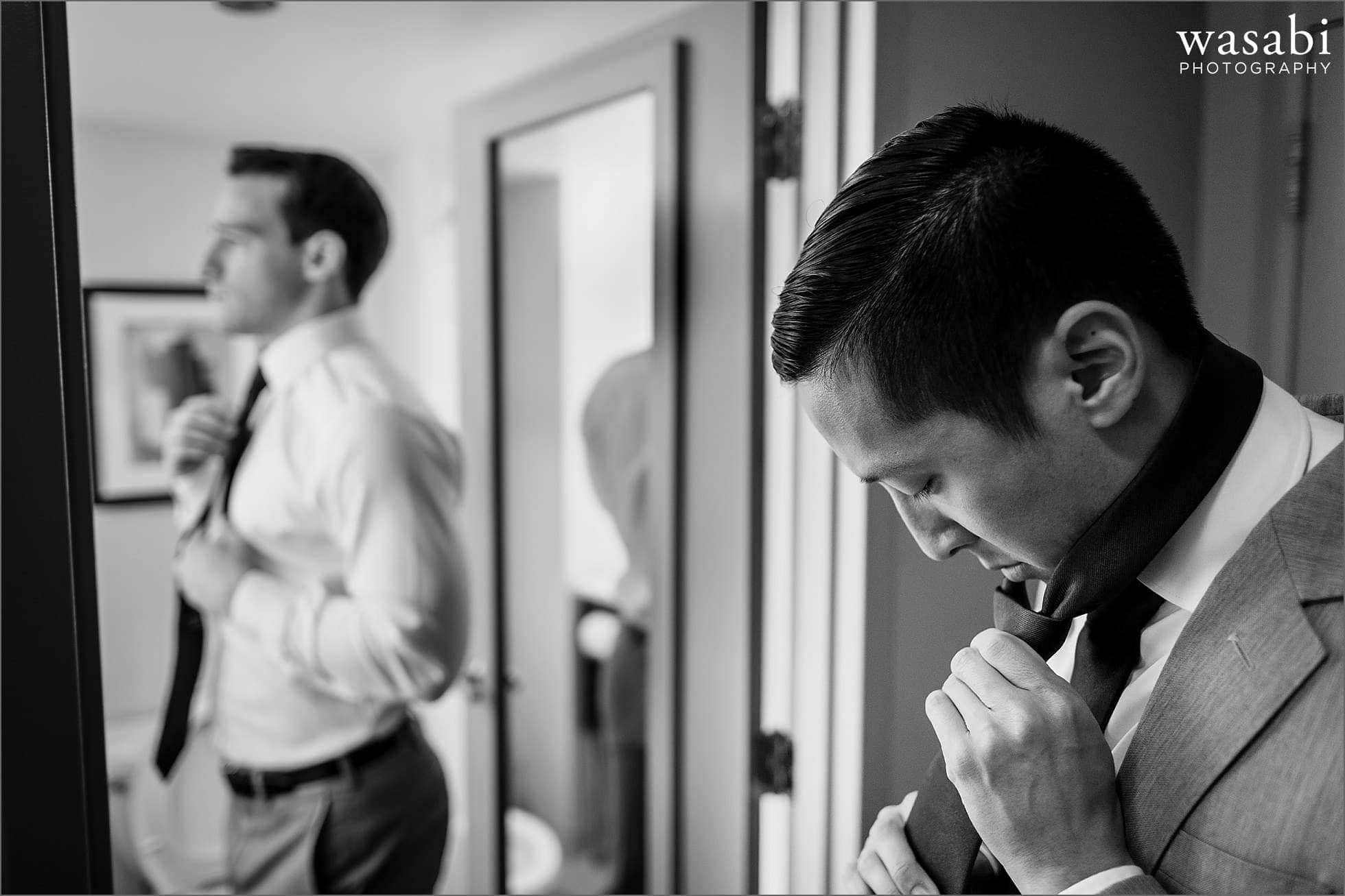 groomsmen put on ties while getting ready for his wedding at Sheraton Grand Hotel in Chicago