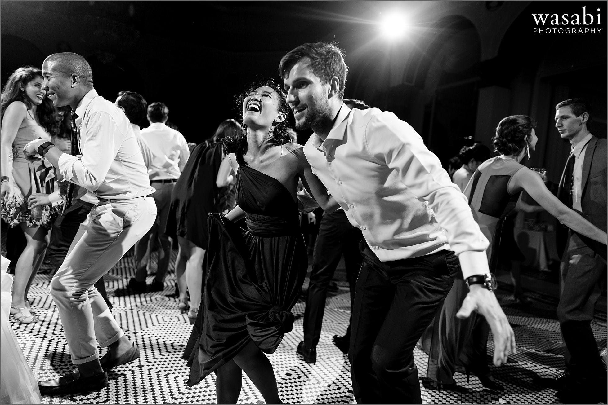guests dance during wedding reception at South Shore Cultural Center