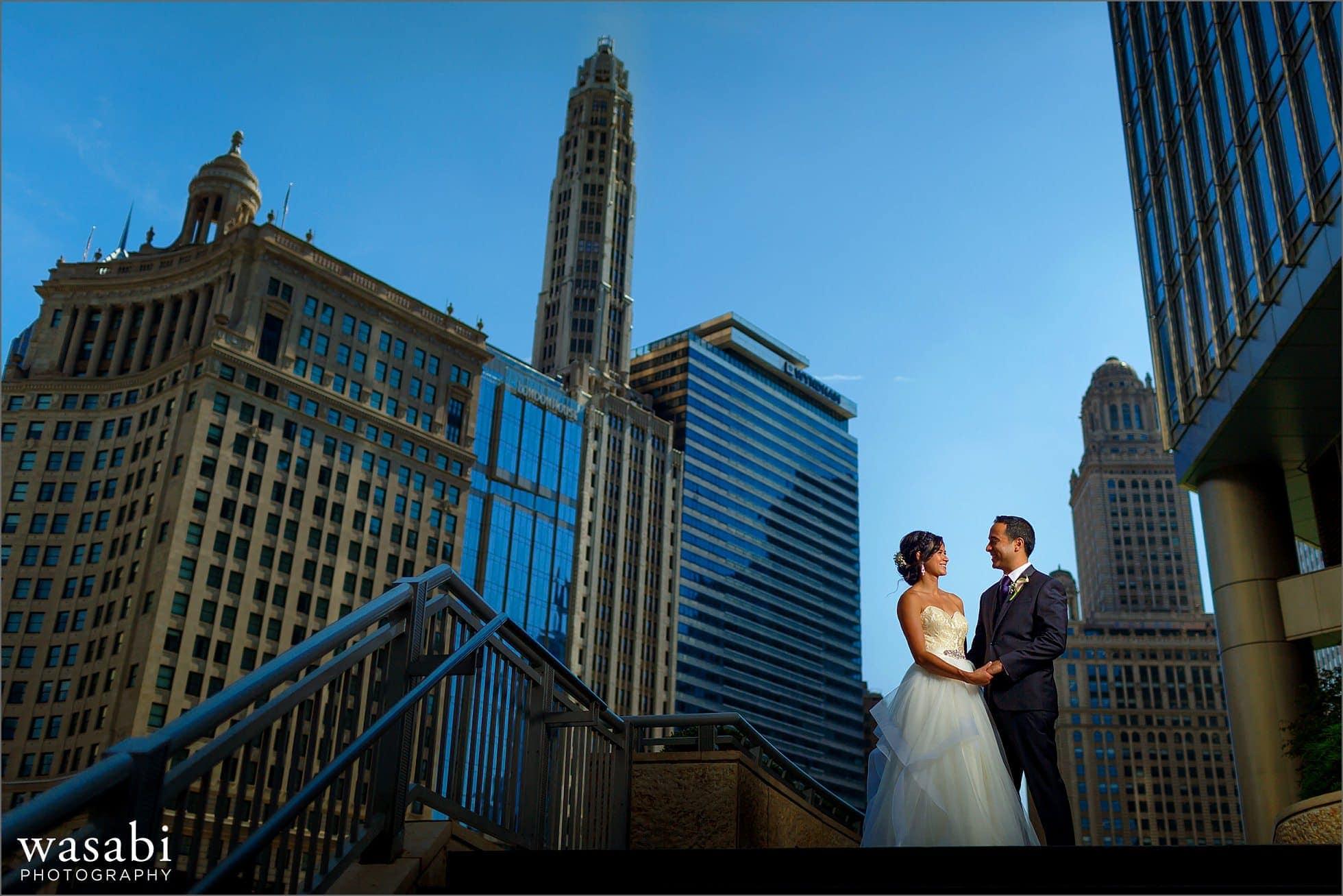 lit blue sky wedding portrait with chicago skyline in background
