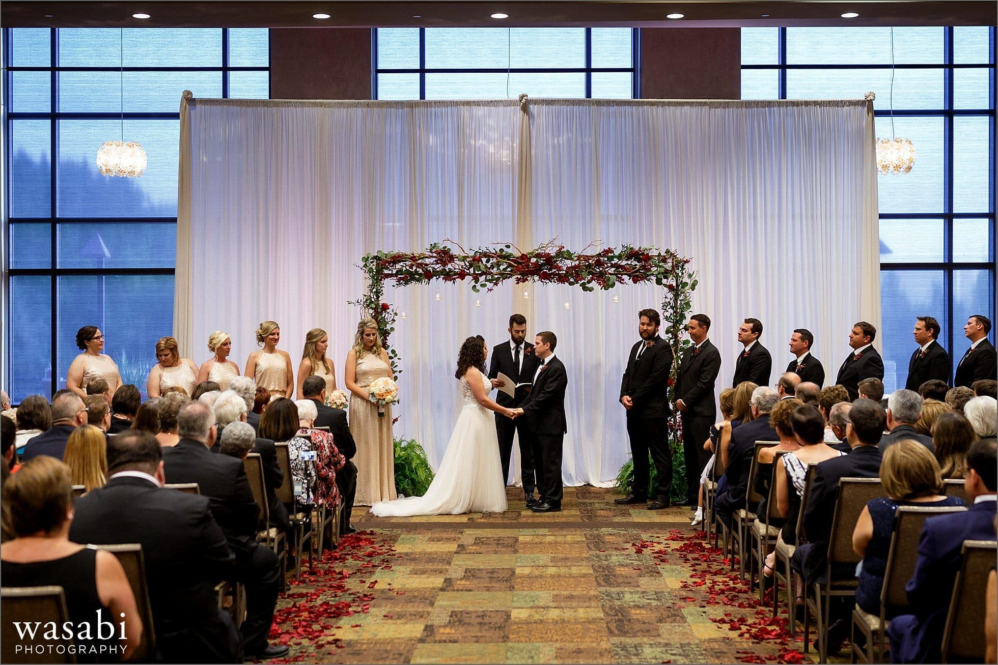 bride and groom exchange vows during their ceremony of Lombard Westin Hotel wedding photos