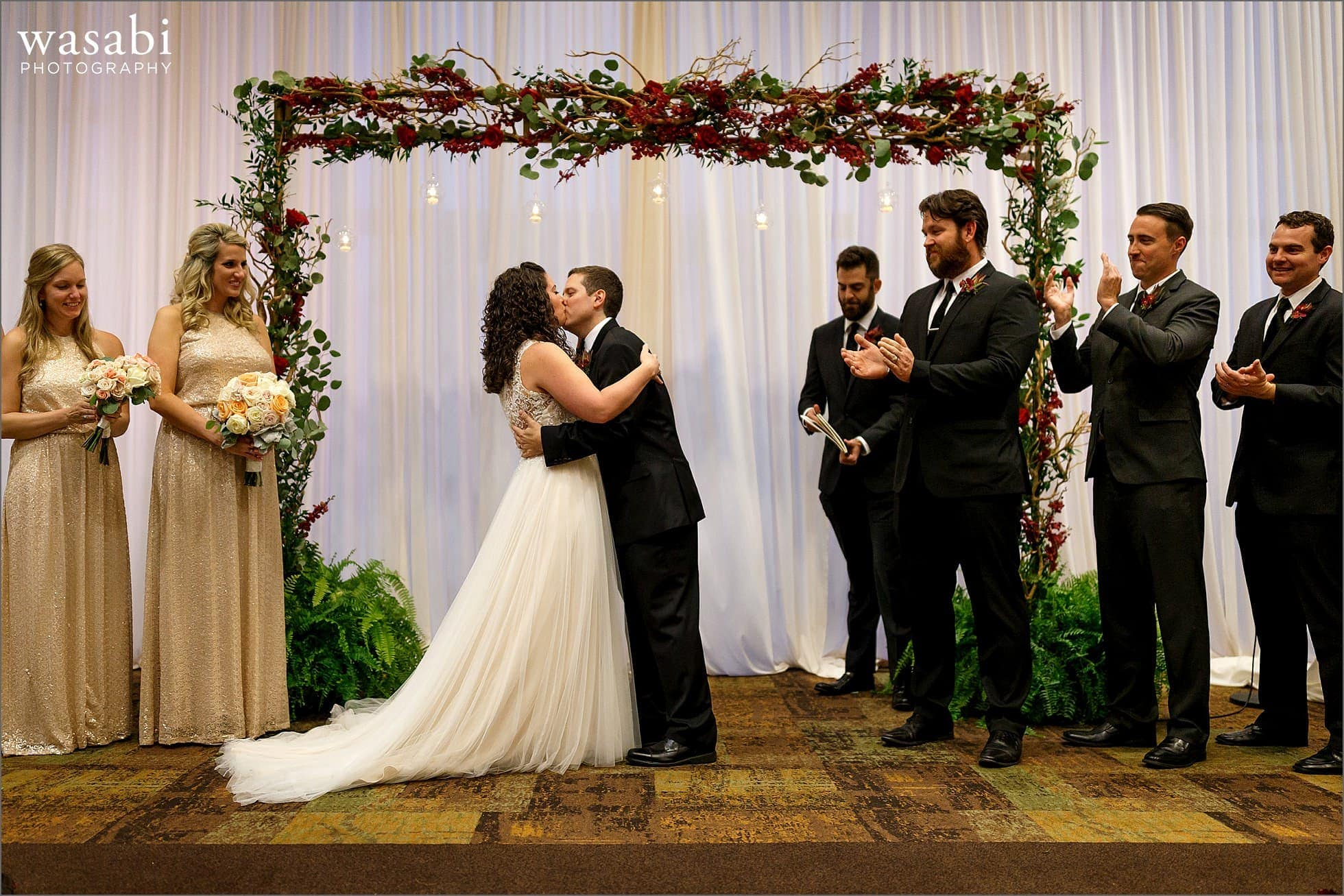 bride and groom kiss at the end of Lombard Westin Hotel wedding photos ceremony