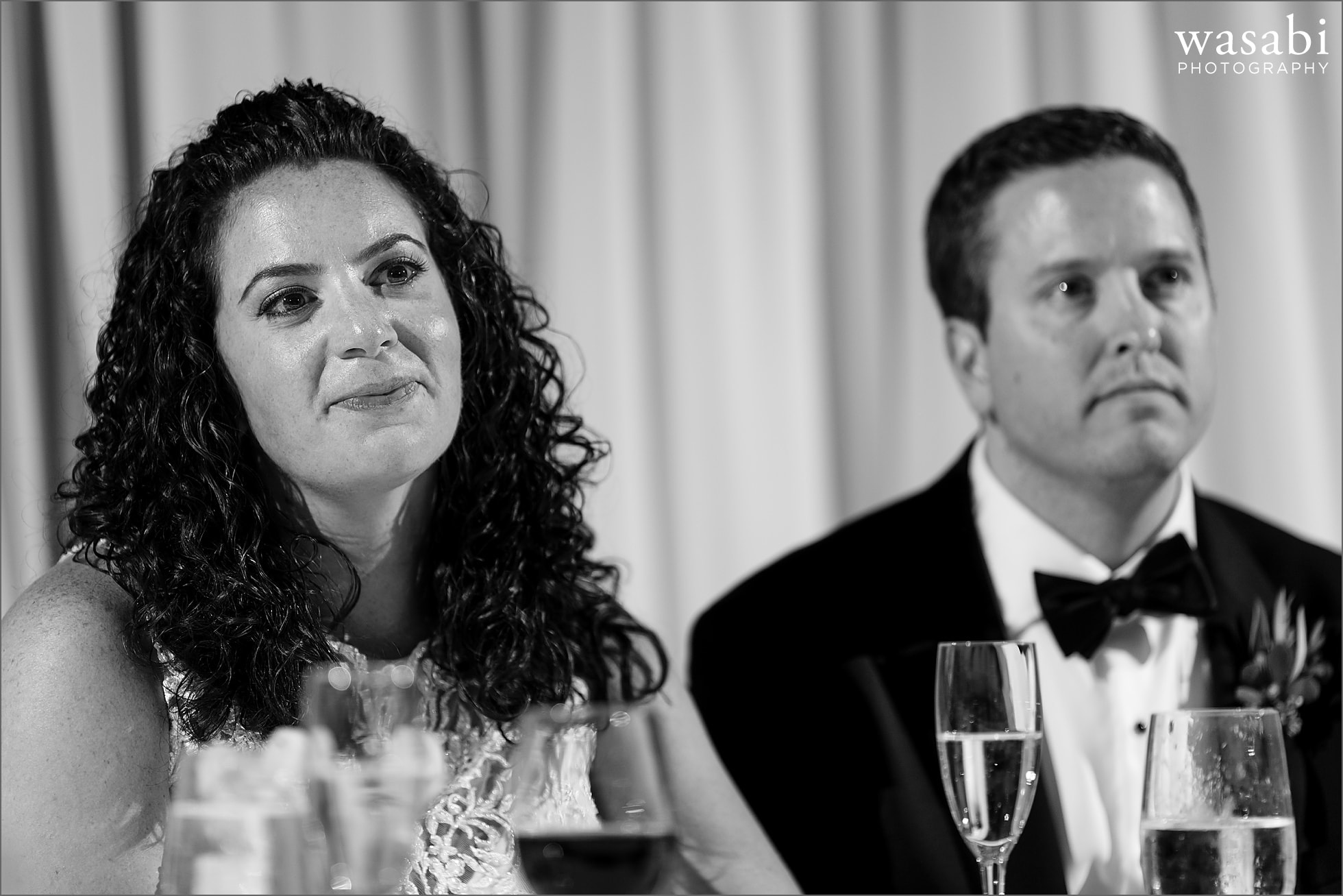 bride and groom listen to toasts during wedding reception at Lombard Westin Hotel