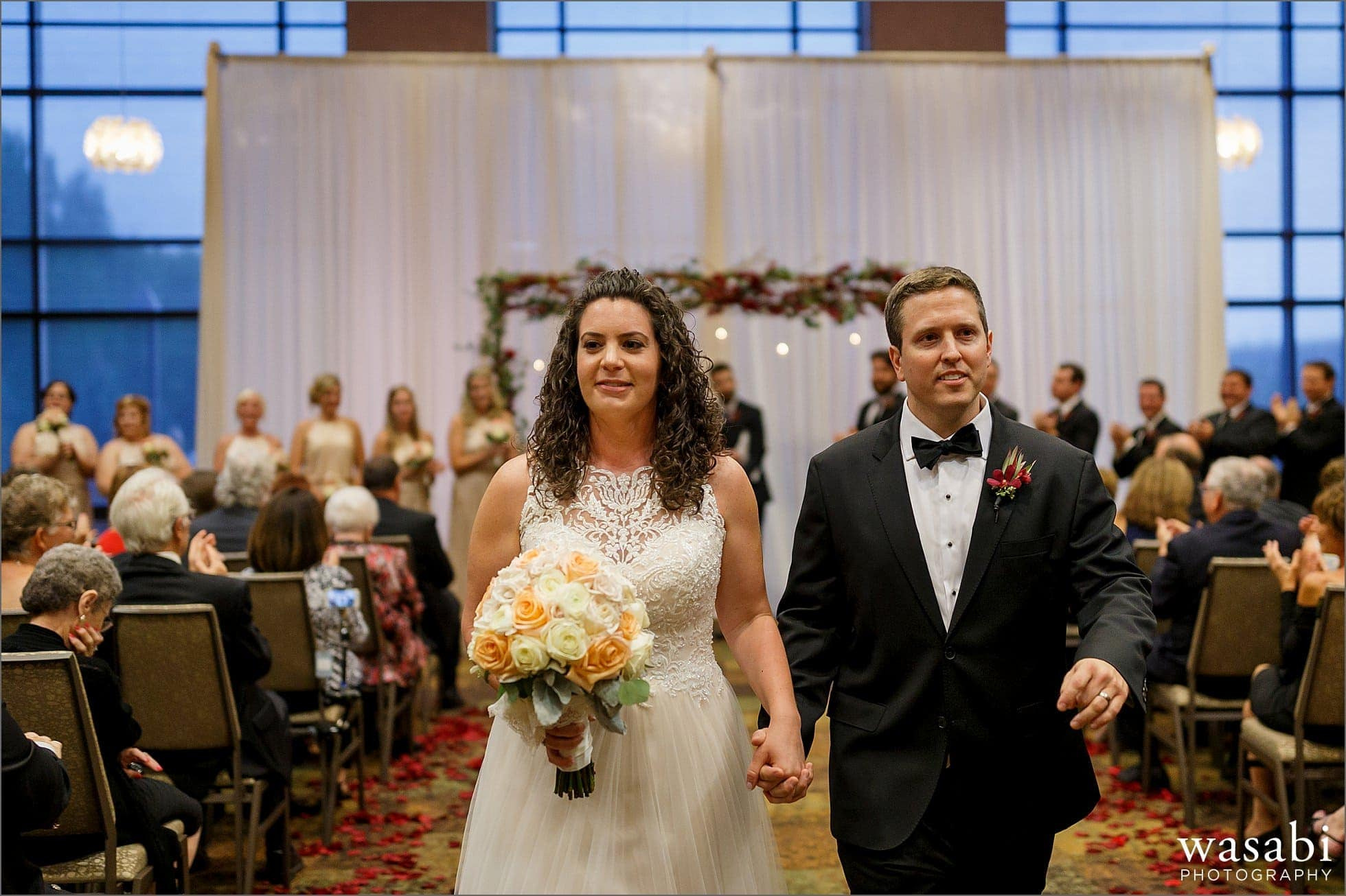bride and groom walk down the aisle after their Lombard Westin hotel wedding ceremony