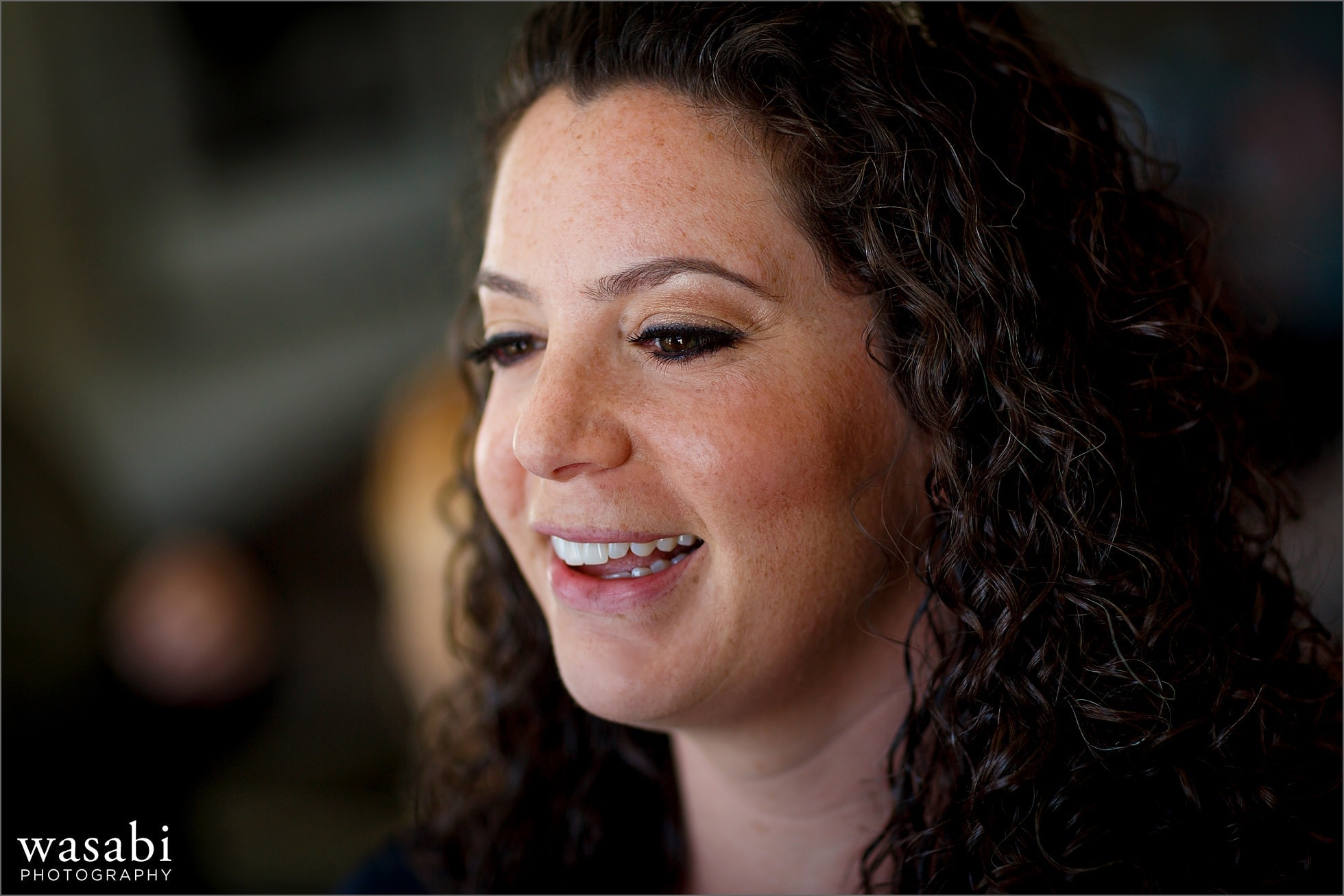closeup bride smiles while getting ready for her wedding at the Lombard Westin Hotel