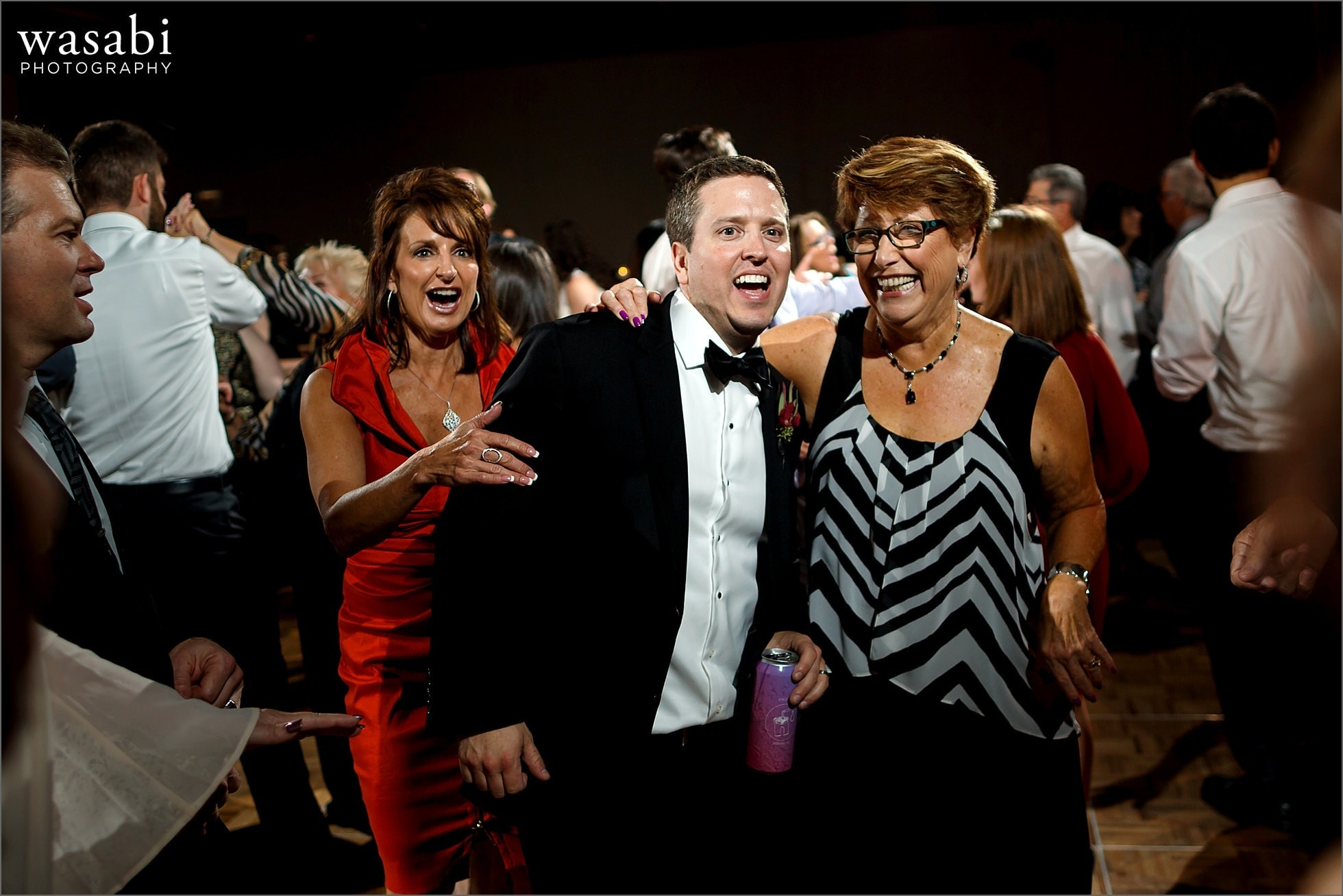 groom dances with guests during wedding reception at Lombard Westin Hotel