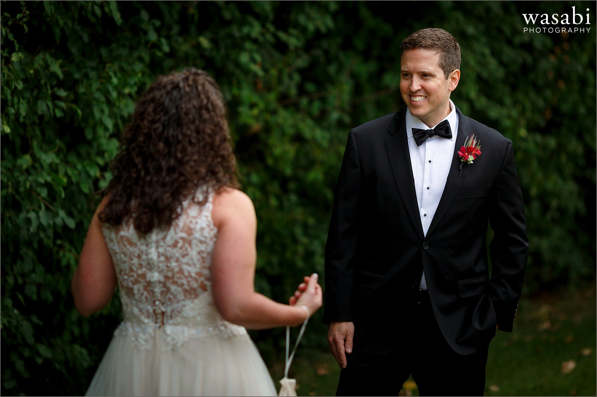 groom smiles after seeing bride during first look at Lombard Westin Hotel